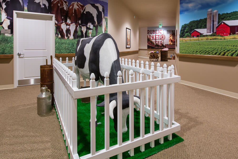 Cow statue in a themed memory care wing of Quail Park at Browns Point in Tacoma, Washington