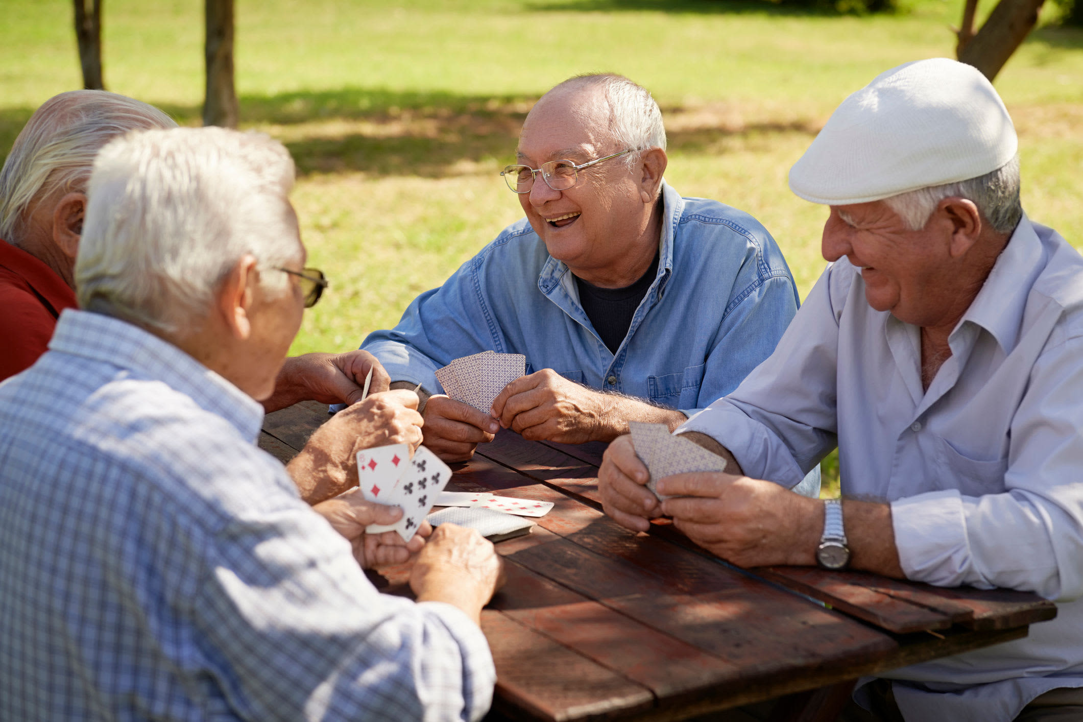 Residents playing cards at Clearwater at South Bay