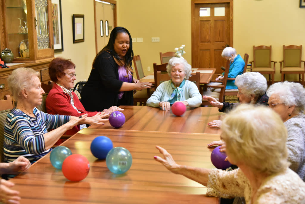 Residents doing a memory care activity at Quail Park Memory Care Residences of Visalia in Visalia, California