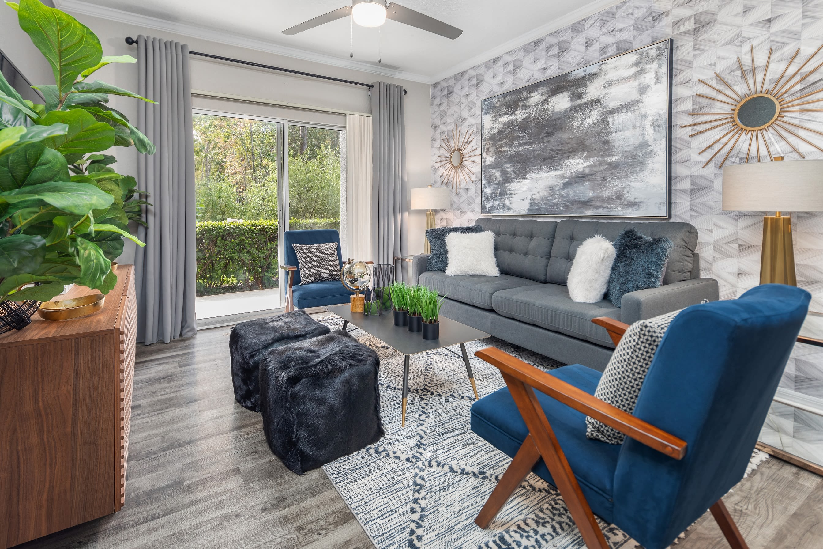 Hardwood floors in living room with porch access at Mezza in Jacksonville, Florida