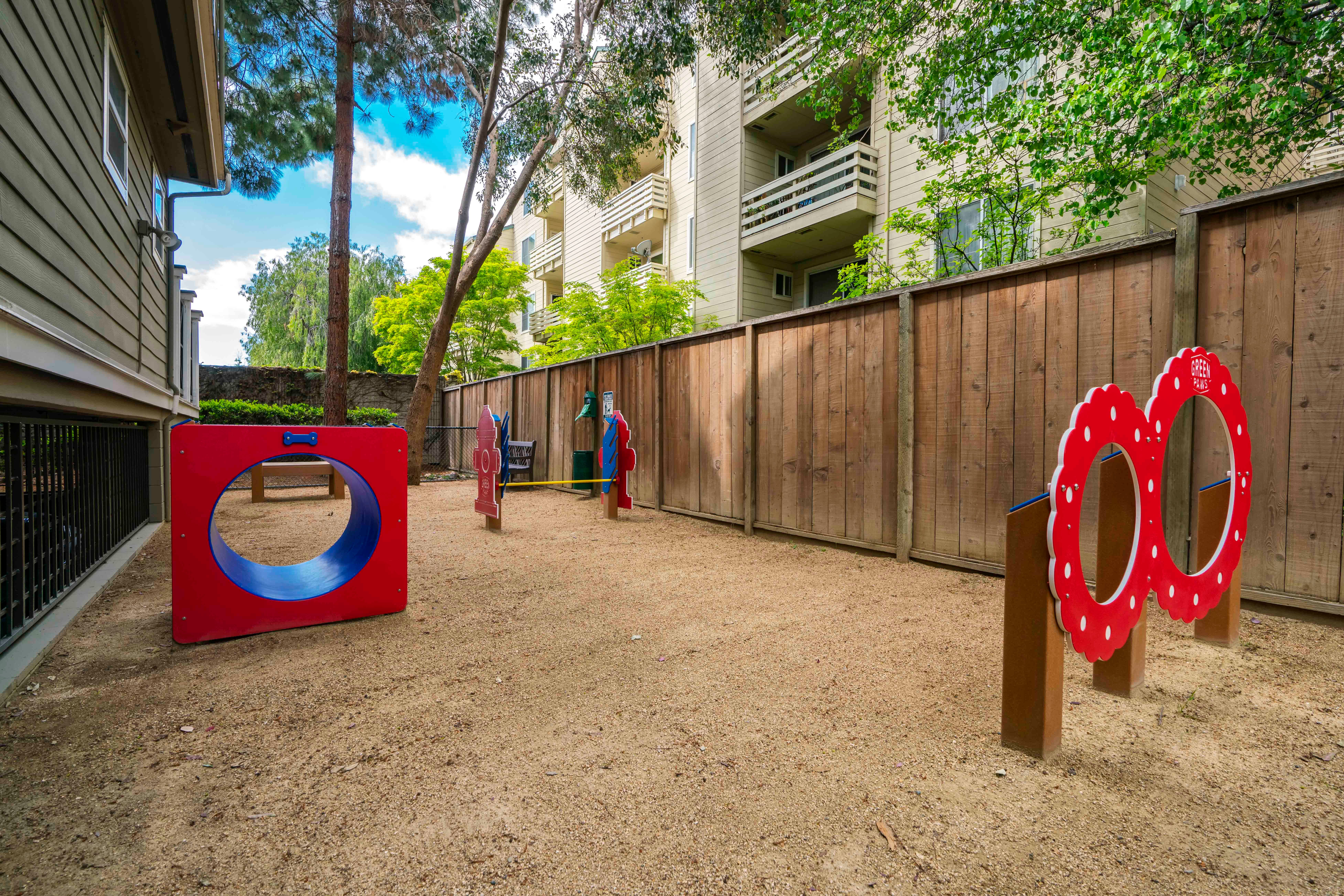On-site dog park with agility equipment at Sofi Sunnyvale in Sunnyvale, California