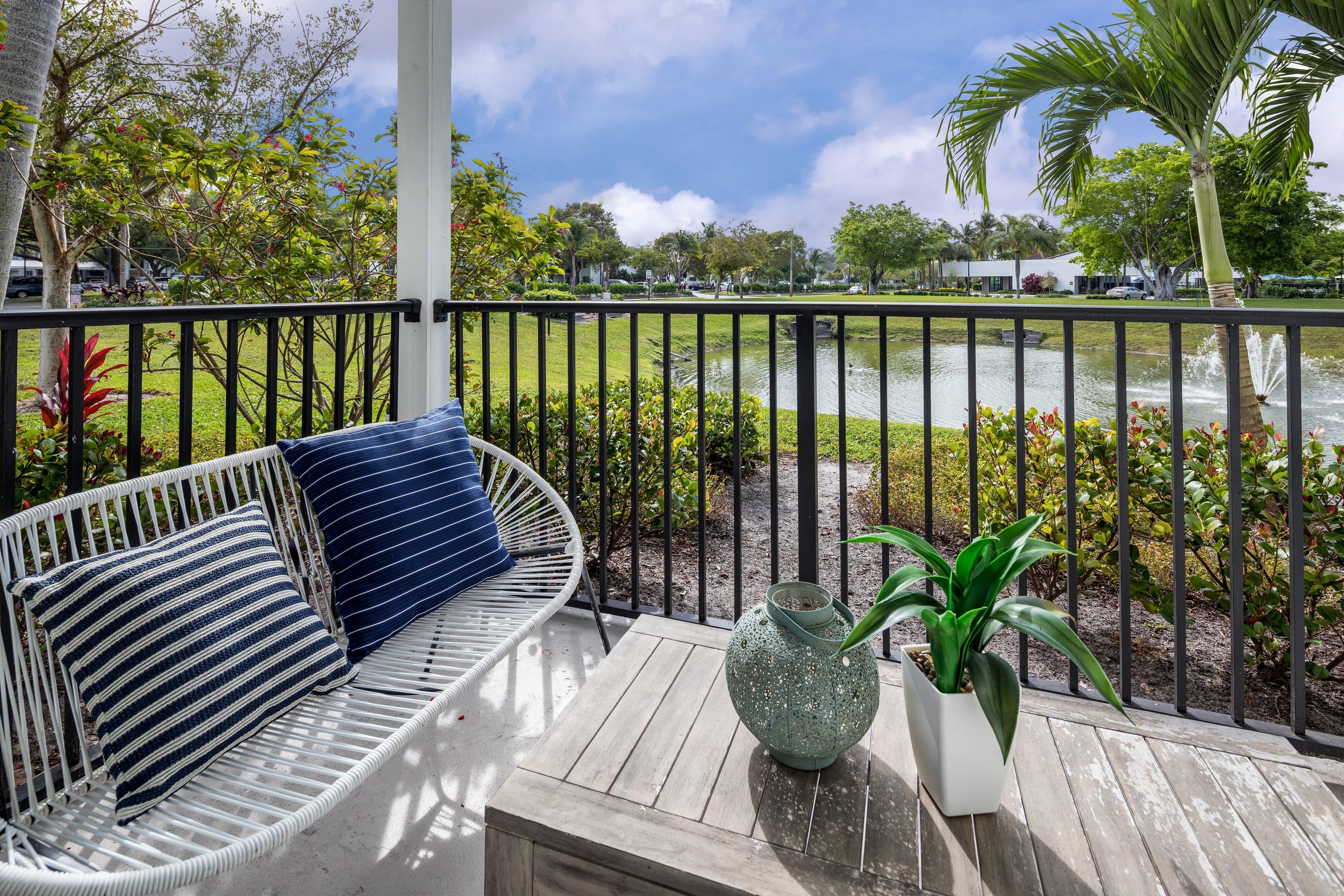 Balcony with outdoor furniture at Cielo Boca in Boca Raton, Florida