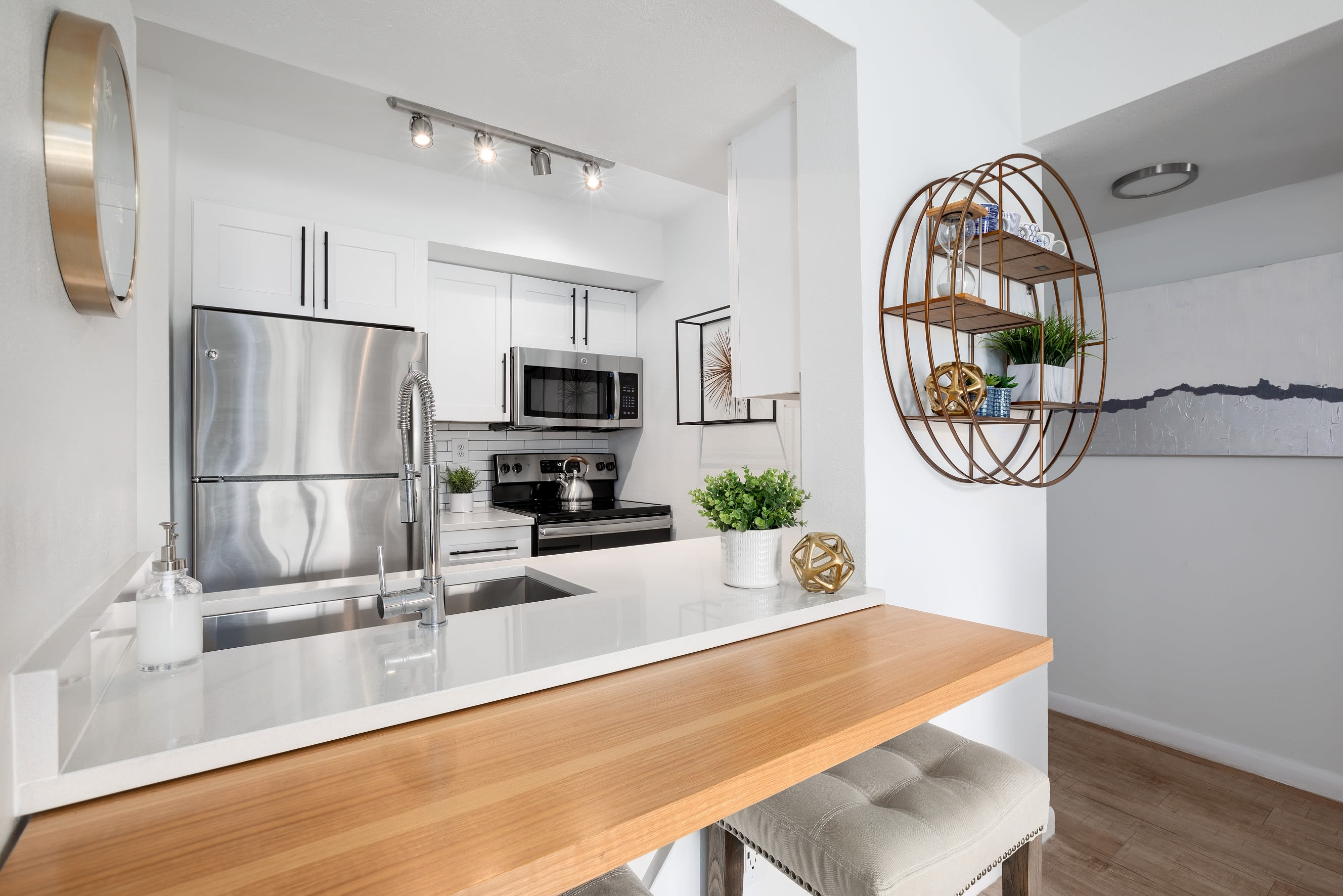 Modern kitchen with bar at Cielo Boca in Boca Raton, Florida