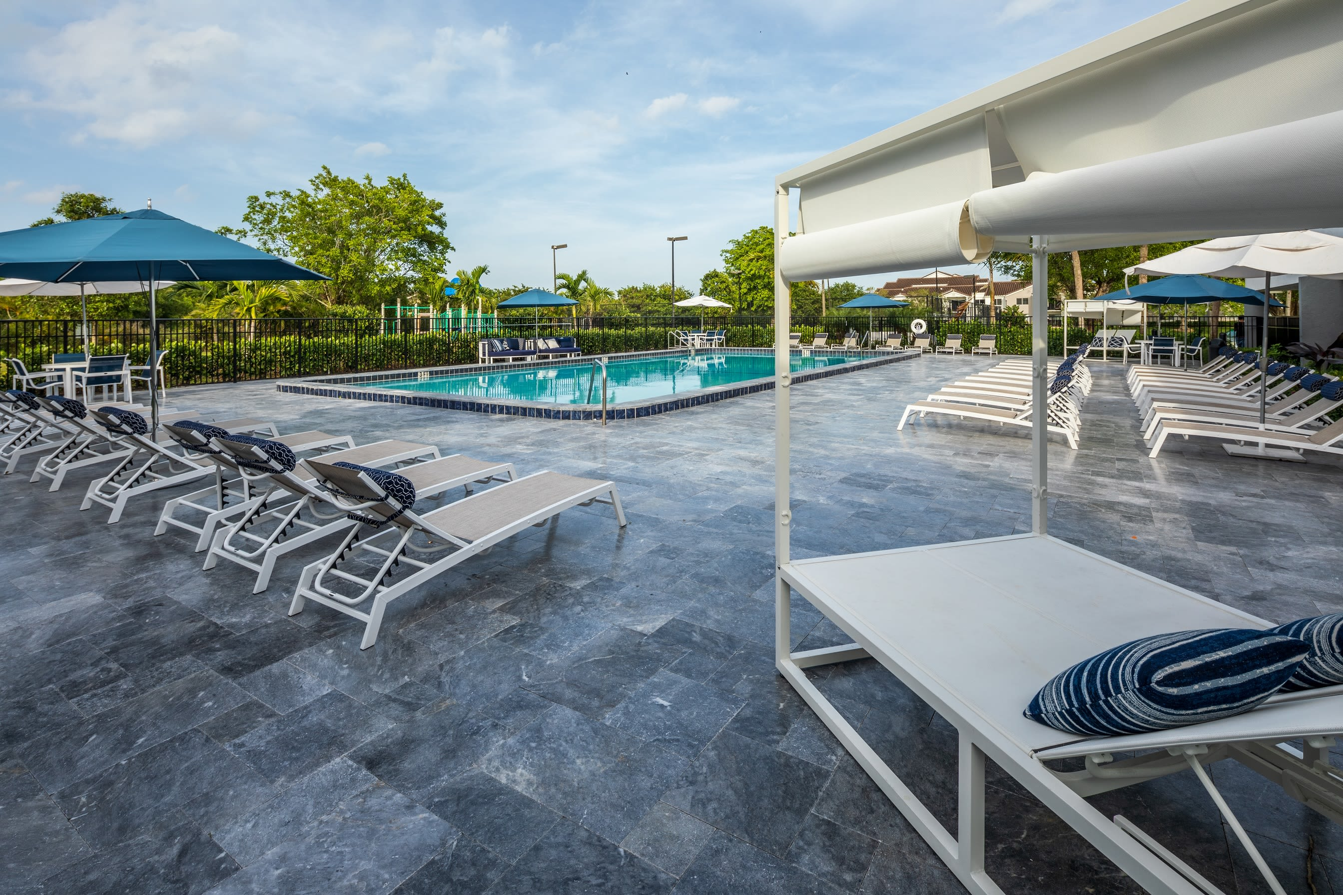 Beautiful outdoor pool with lounge chairs at Cielo Boca in Boca Raton, Florida