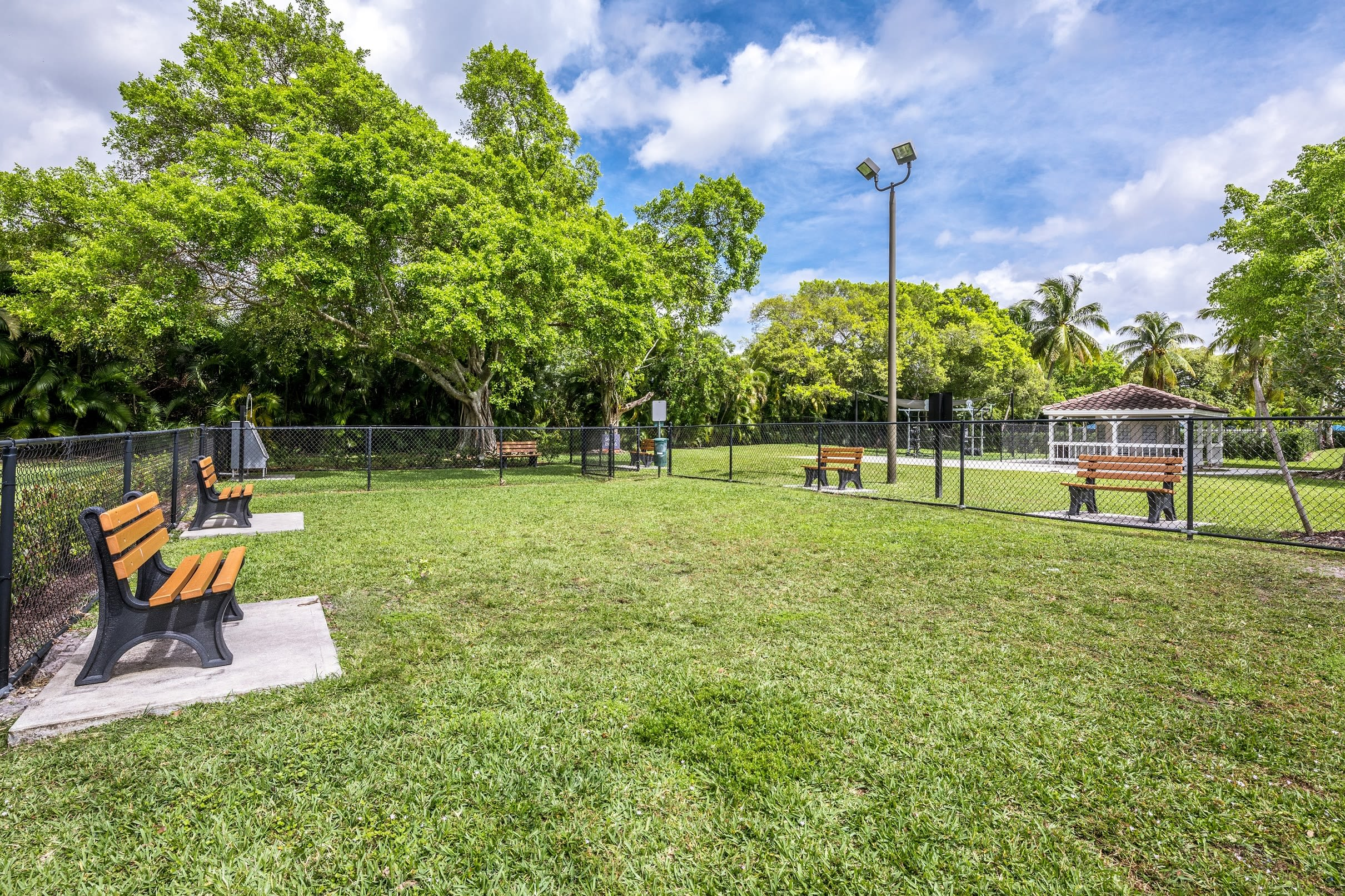 Benches and green space for dog park at Cielo Boca in Boca Raton, Florida