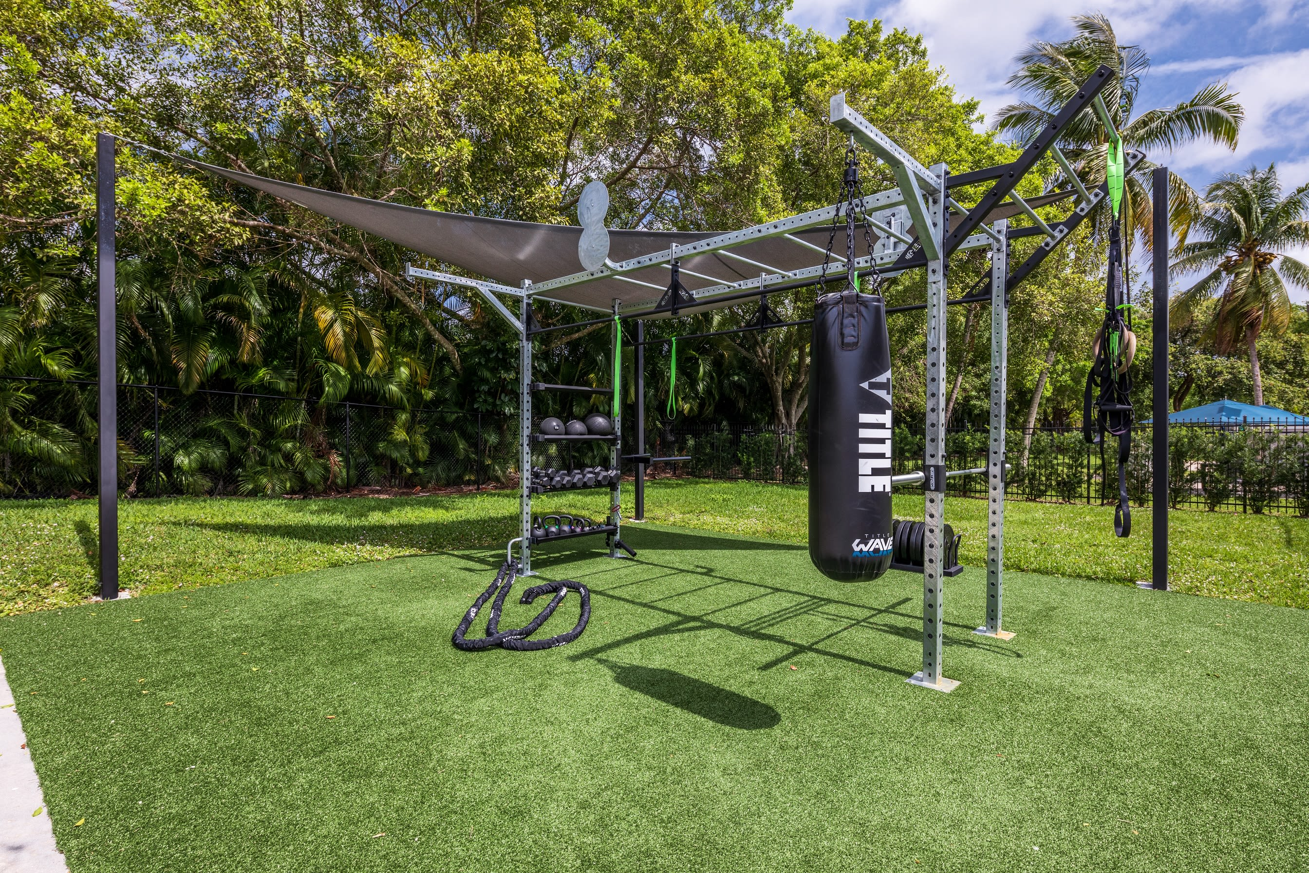 Outdoor fitness area with boxing bag at Cielo Boca in Boca Raton, Florida