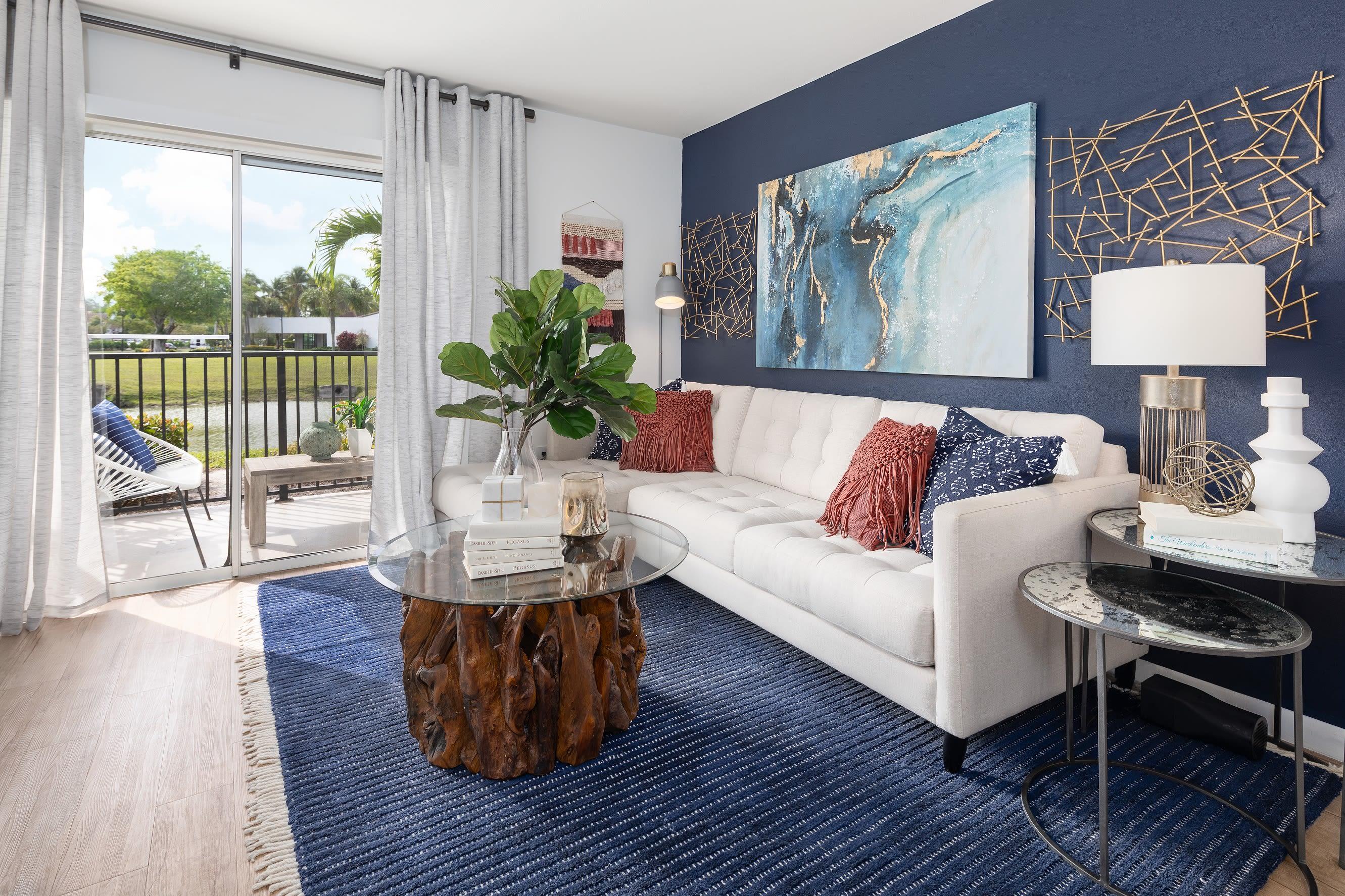 Living room with patio access at Cielo Boca in Boca Raton, Florida