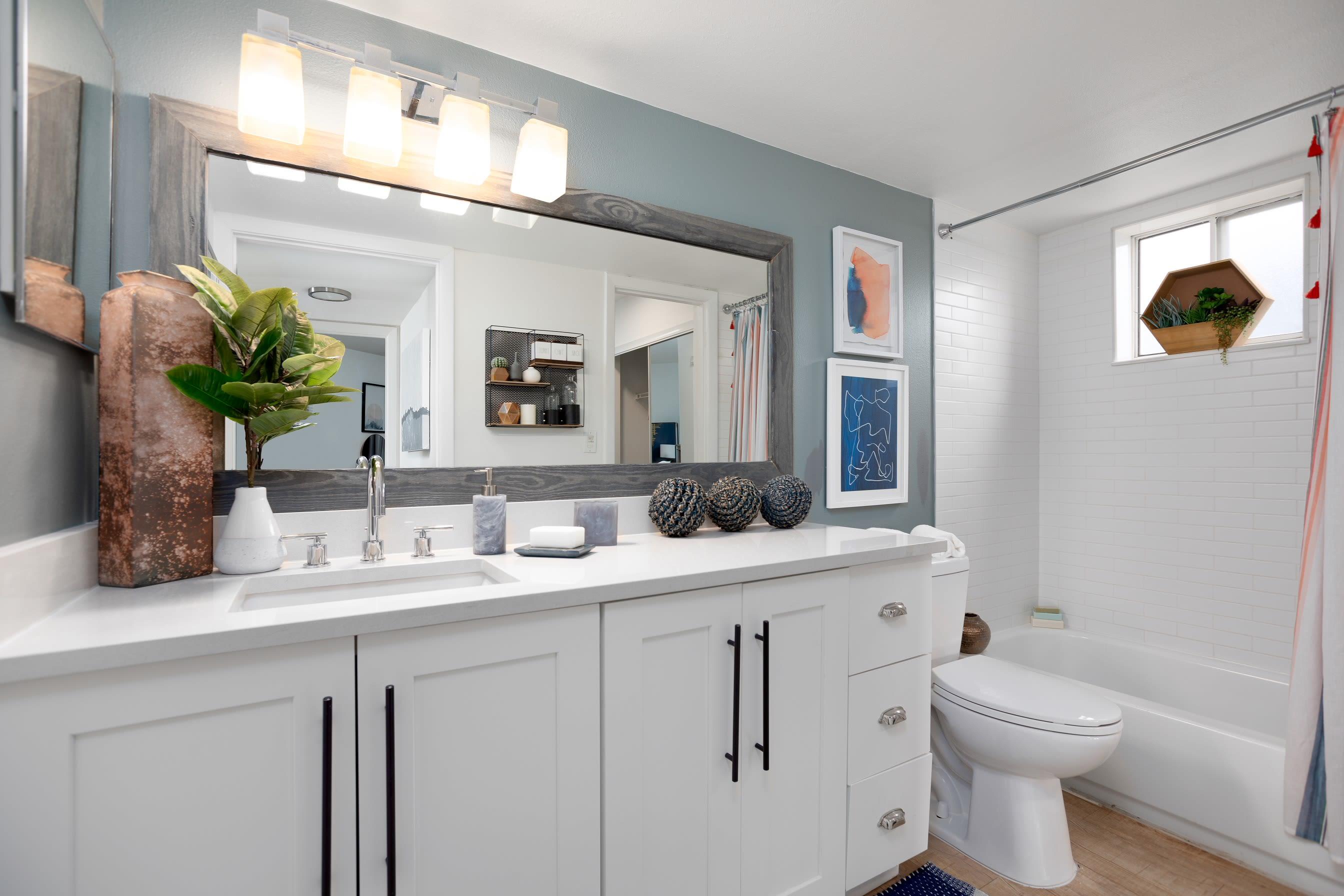 Large bathroom with vanity mirror at Cielo Boca in Boca Raton, Florida