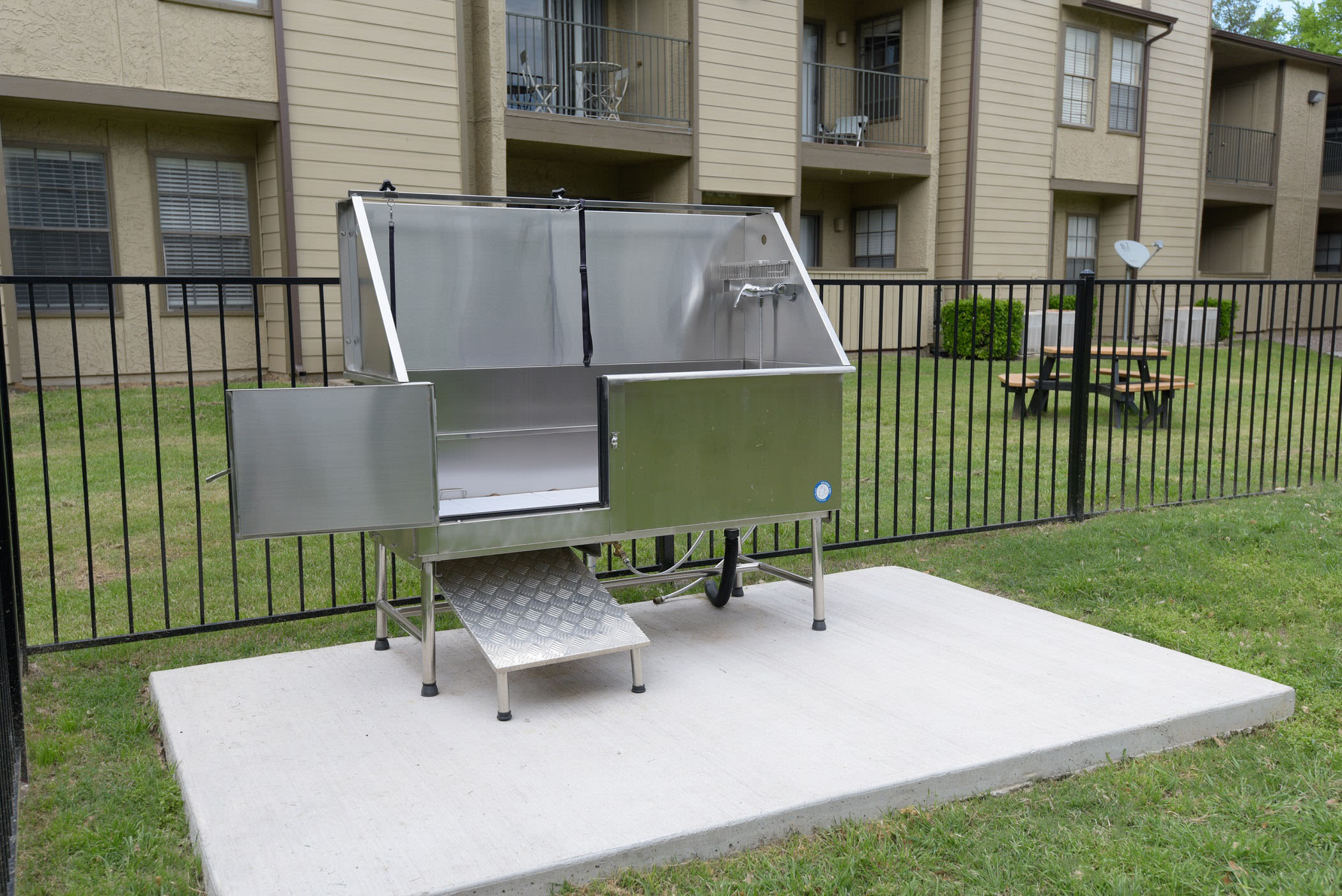 Onsite dog park with dog wash station at The Regent in Dallas, Texas