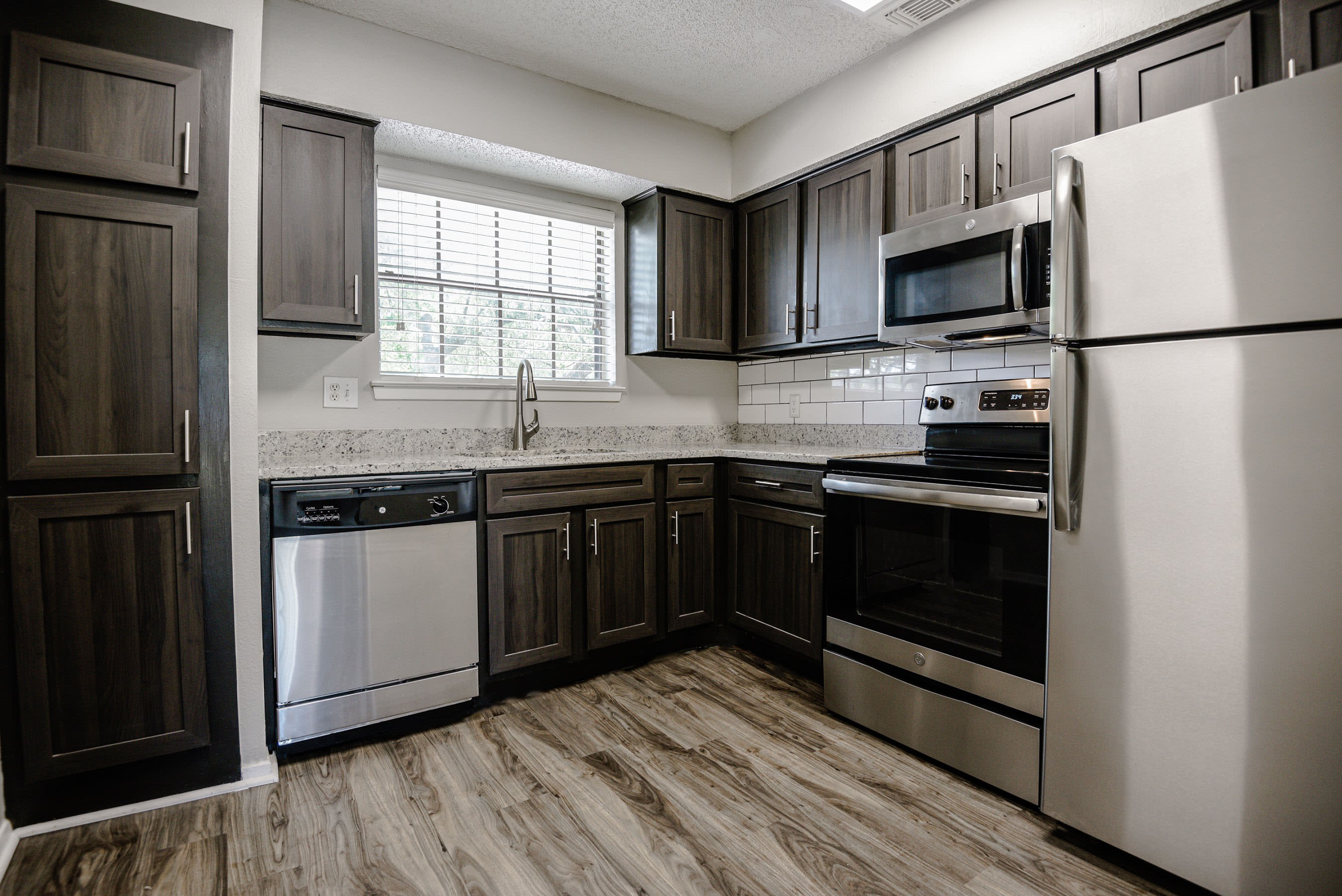 Kitchen with plenty of counter space and stainless-steel appliances at The Regent in Dallas, Texas