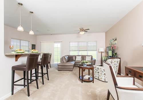 Bright, spacious living room at Preserve at Autumn Ridge in Watertown, New York