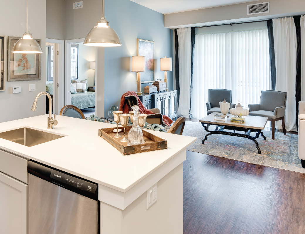 Open dining and living area at Avenida Naperville Apartments