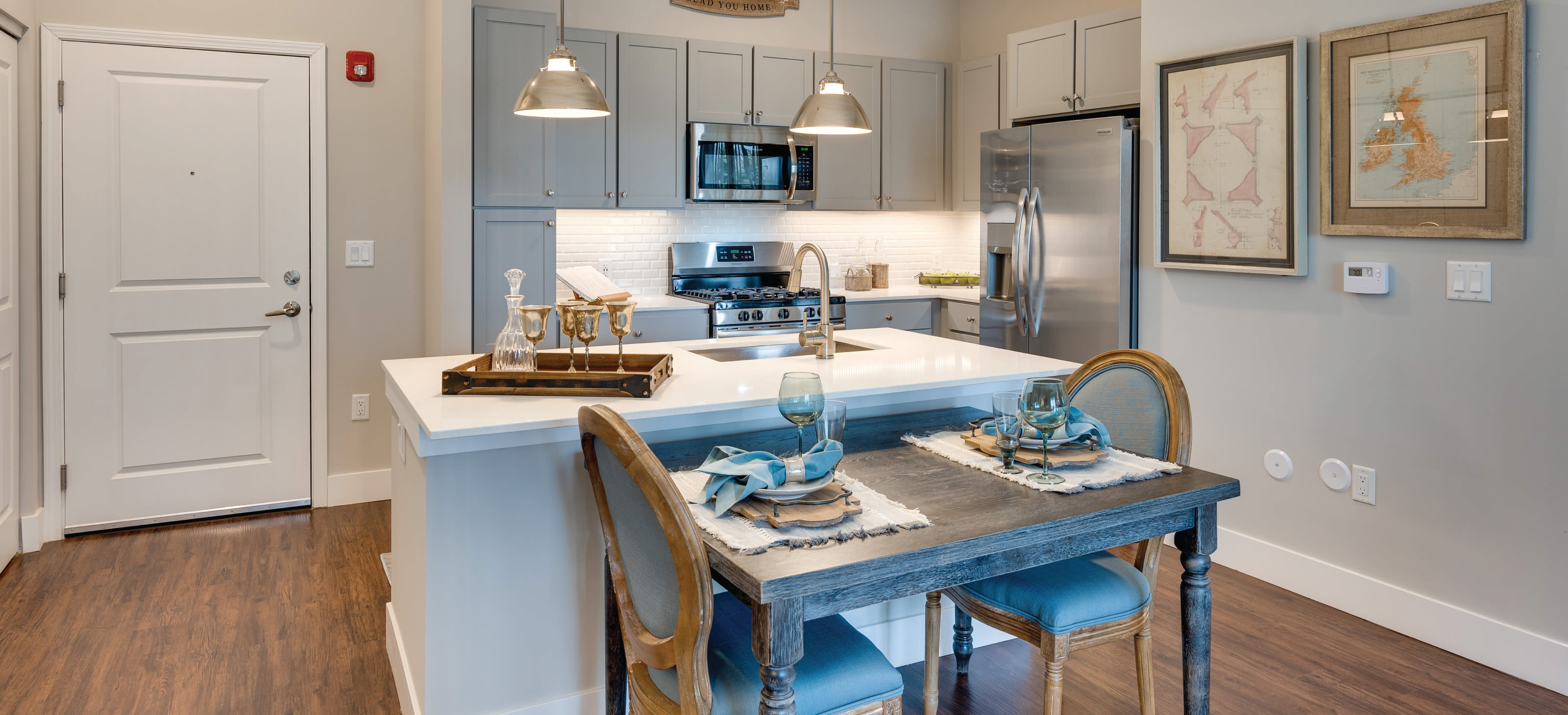Modern kitchen and entrance - Avenida Naperville Apartments