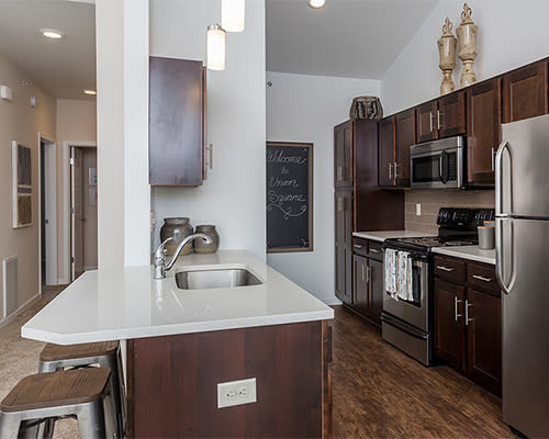 Modern kitchen at Union Square Apartments in North Chili, New York