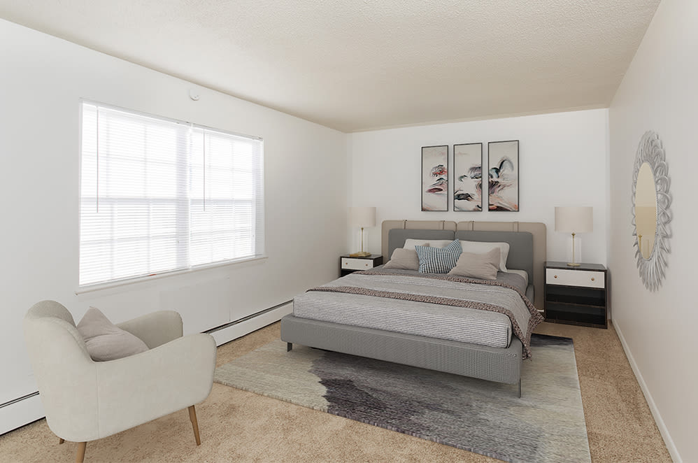 Spacious bedroom at Penfield Village Apartments in Penfield, New York