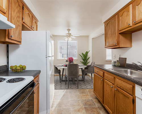 Bright, fully-equipped kitchen at East Ridge Manor Apartments in Rochester, New York
