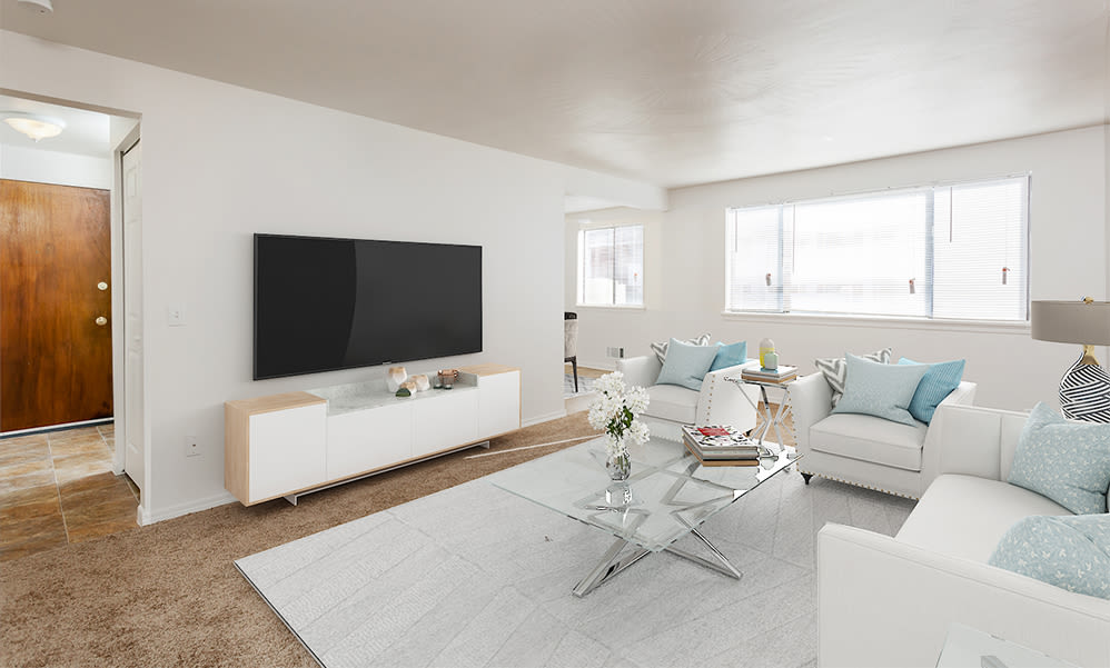 Bright living room at East Ridge Manor Apartments in Rochester, New York