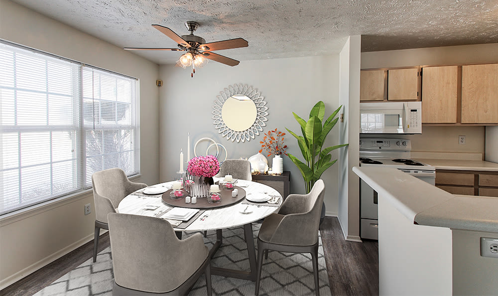Dining area with a ceiling fan at Westview Commons Apartments in Rochester, New York