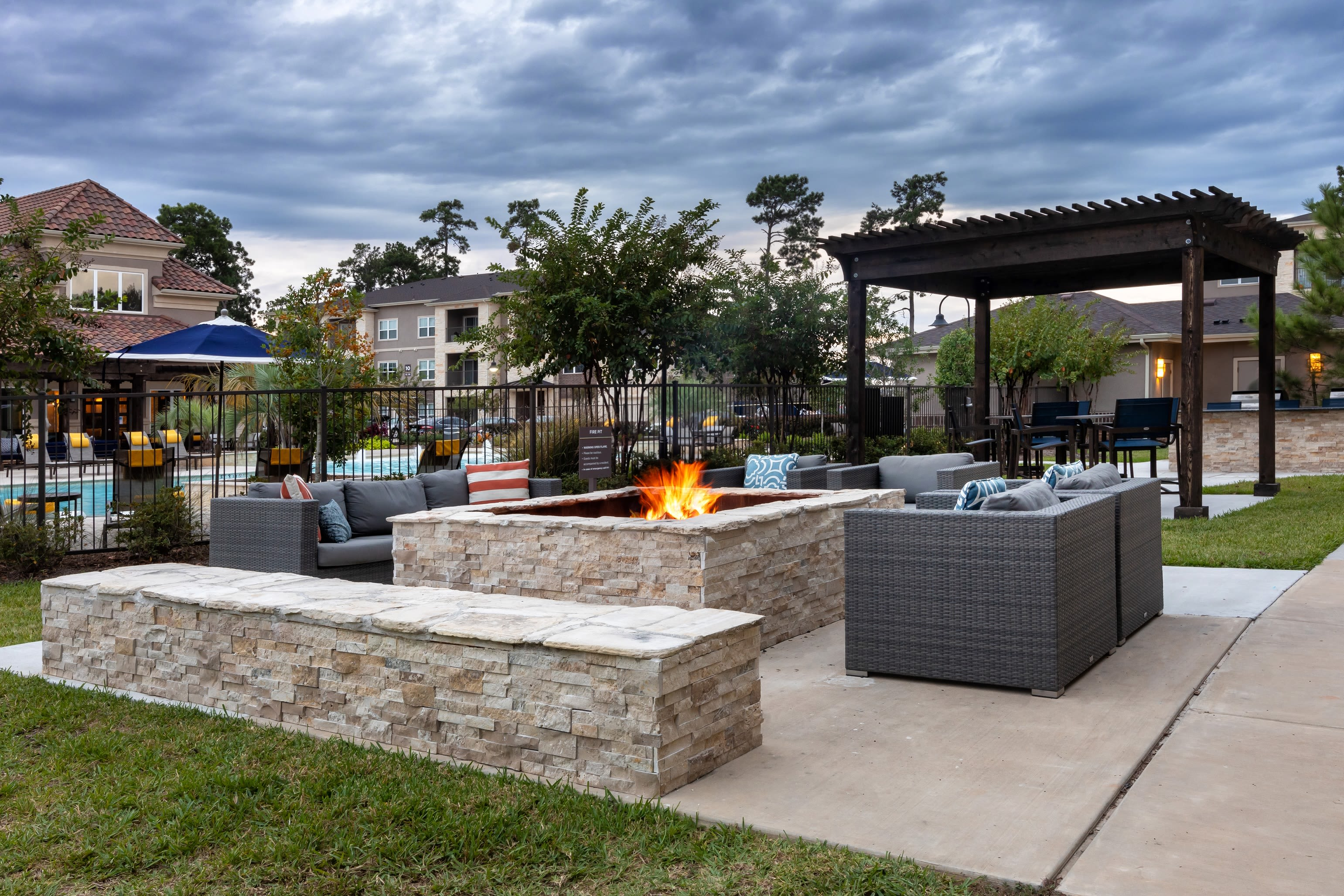View virtual of the fire pit and outdoor grill area at Hilltops in Conroe, Texas