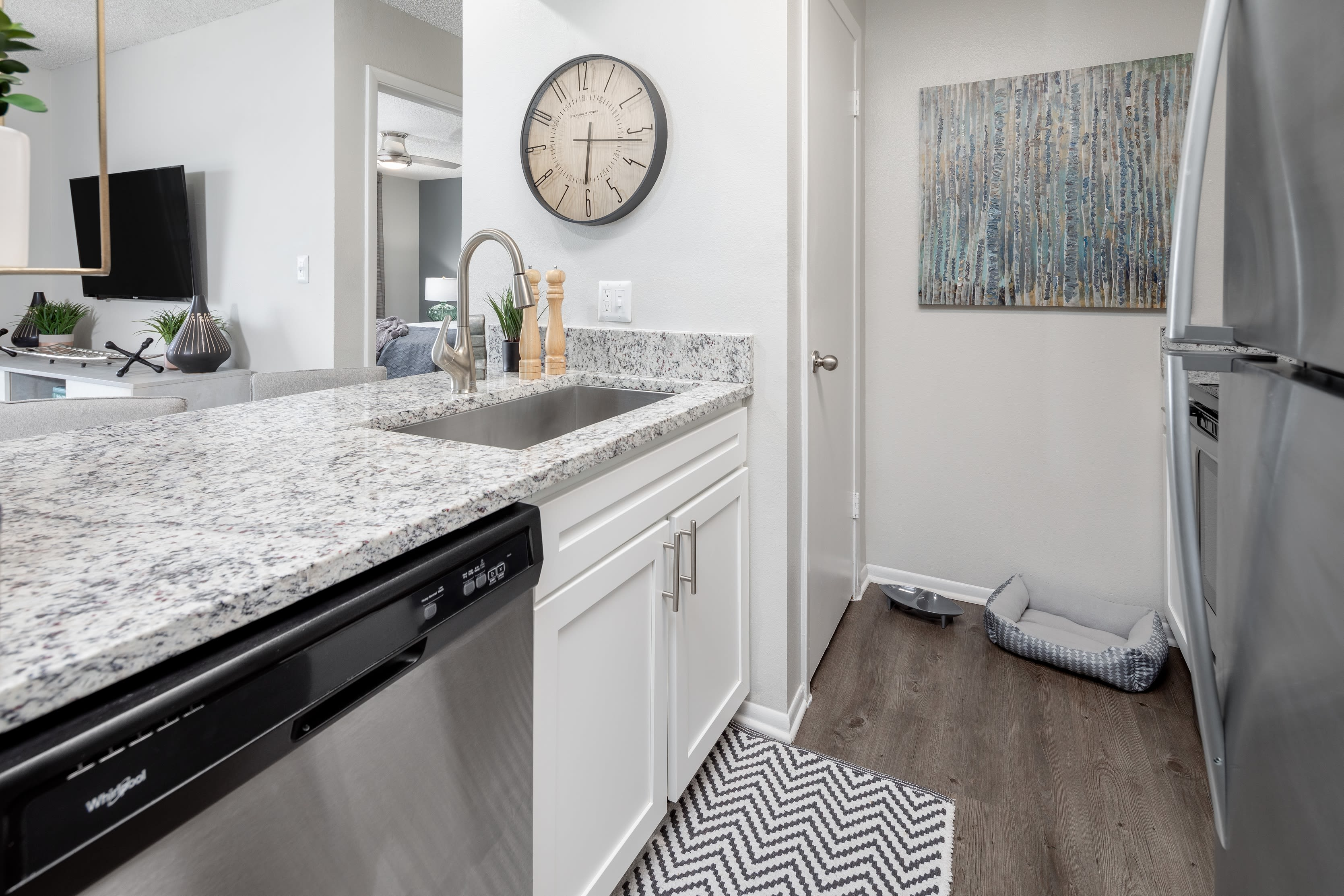 Renovated kitchen with stainless steel appliances and granite countertops at Compass in Melbourne, Florida