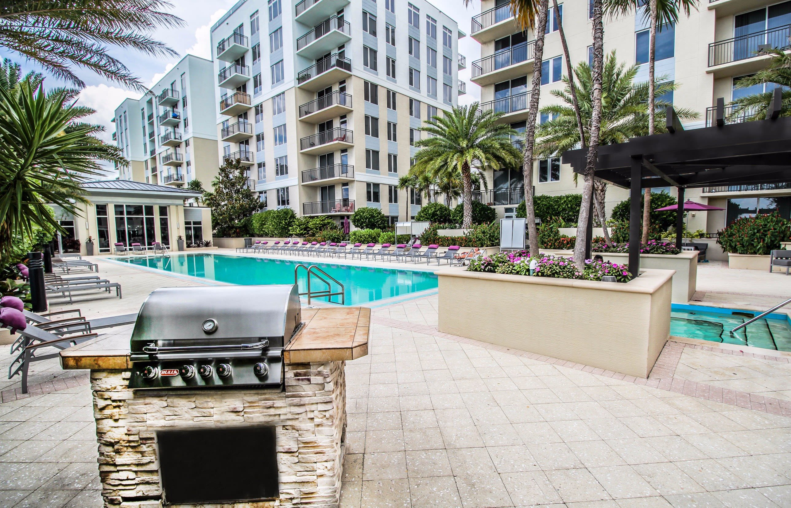 Beautiful hot tub underneath a wooden pergola at Midtown 24 in Plantation, Florida