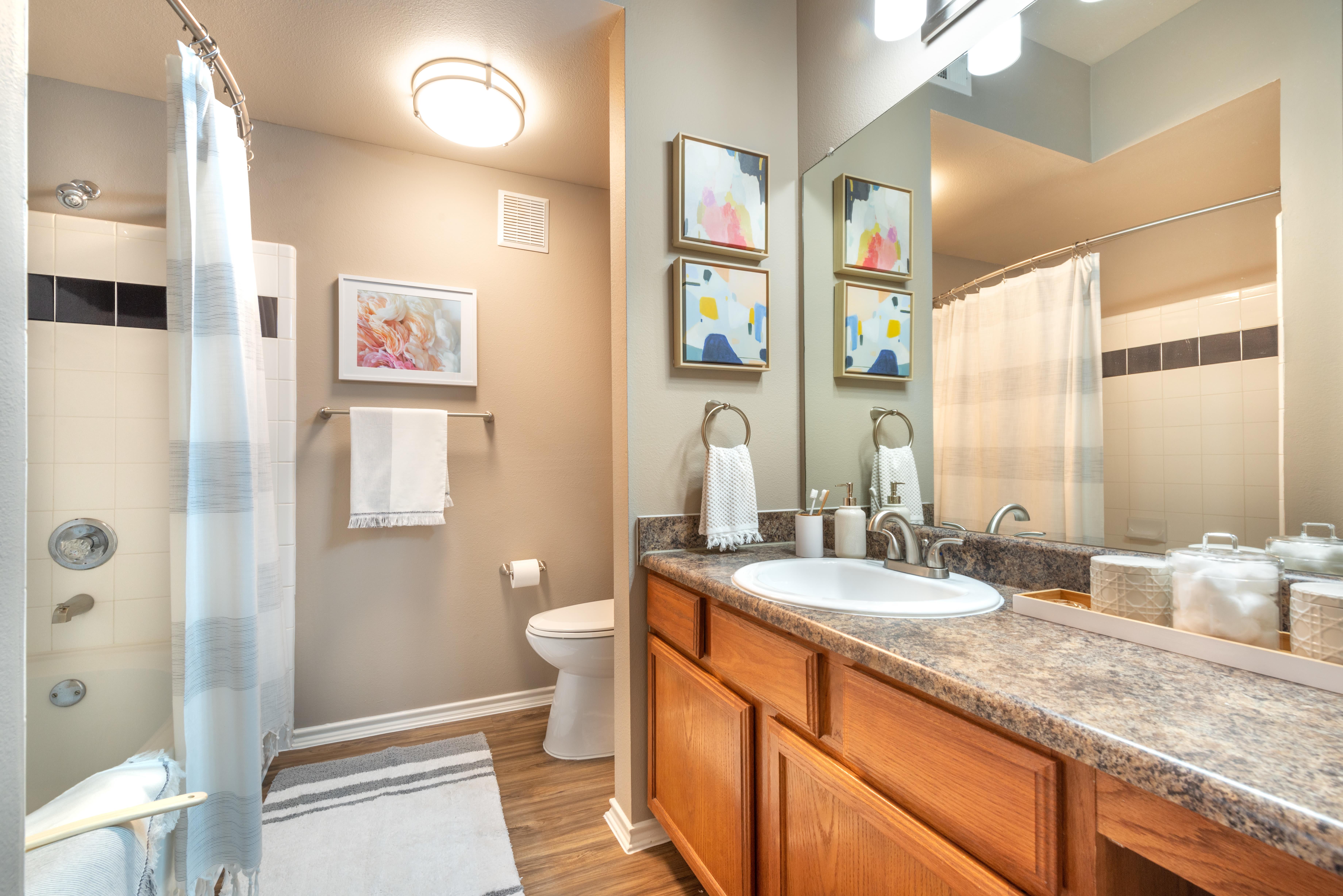 Granite countertop in a model home's bathroom at Olympus Team Ranch in Benbrook, Texas