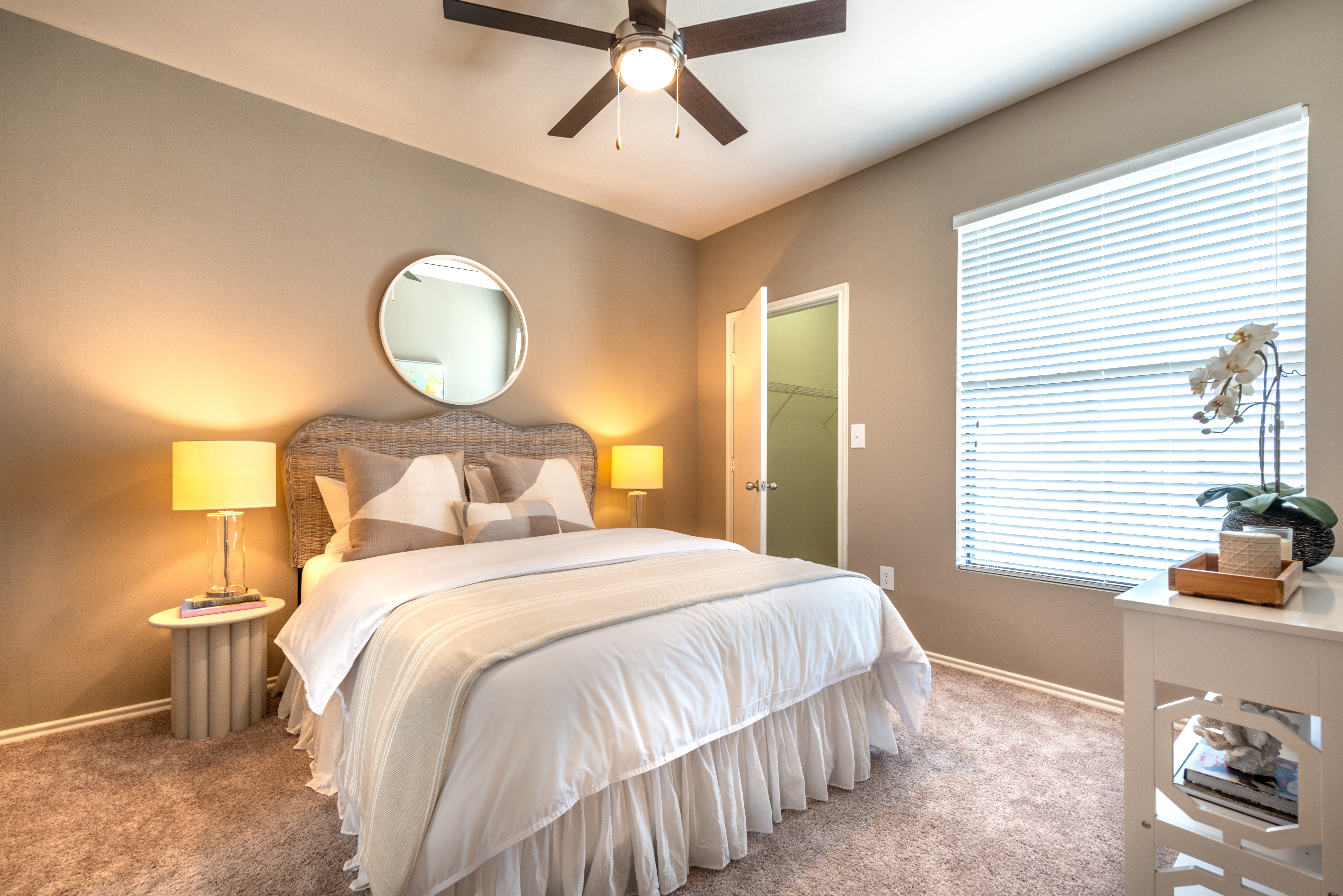 Well-furnished model home's bedroom at Olympus Team Ranch in Benbrook, Texas
