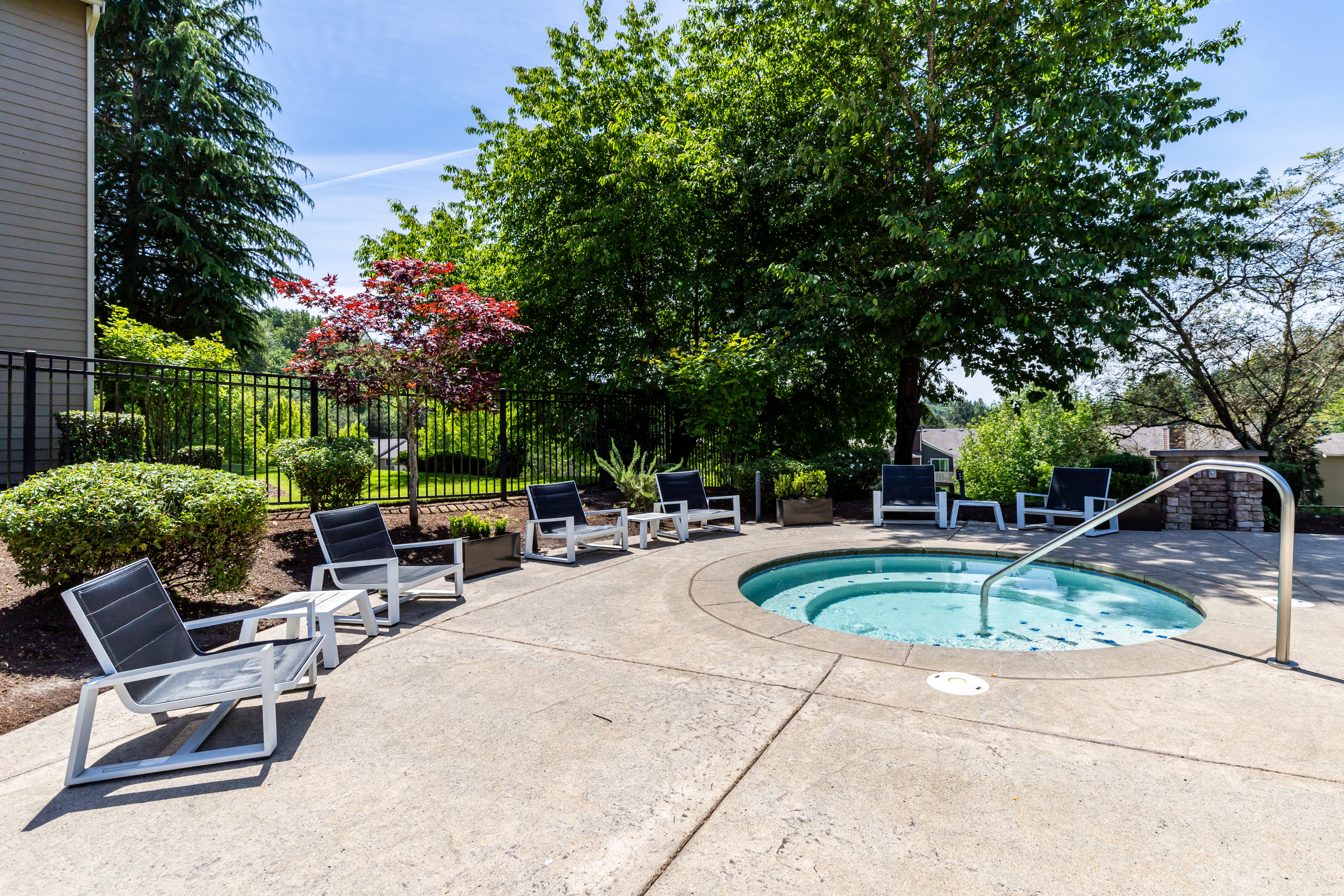 Hot tub by the pool at The Preserve at Forbes Creek in Kirkland, Washington
