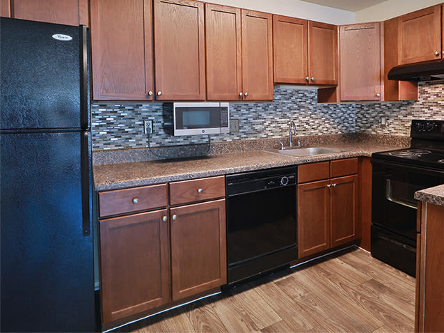 Fully-equipped kitchen at St. Mary's Landing Apartments & Townhomes