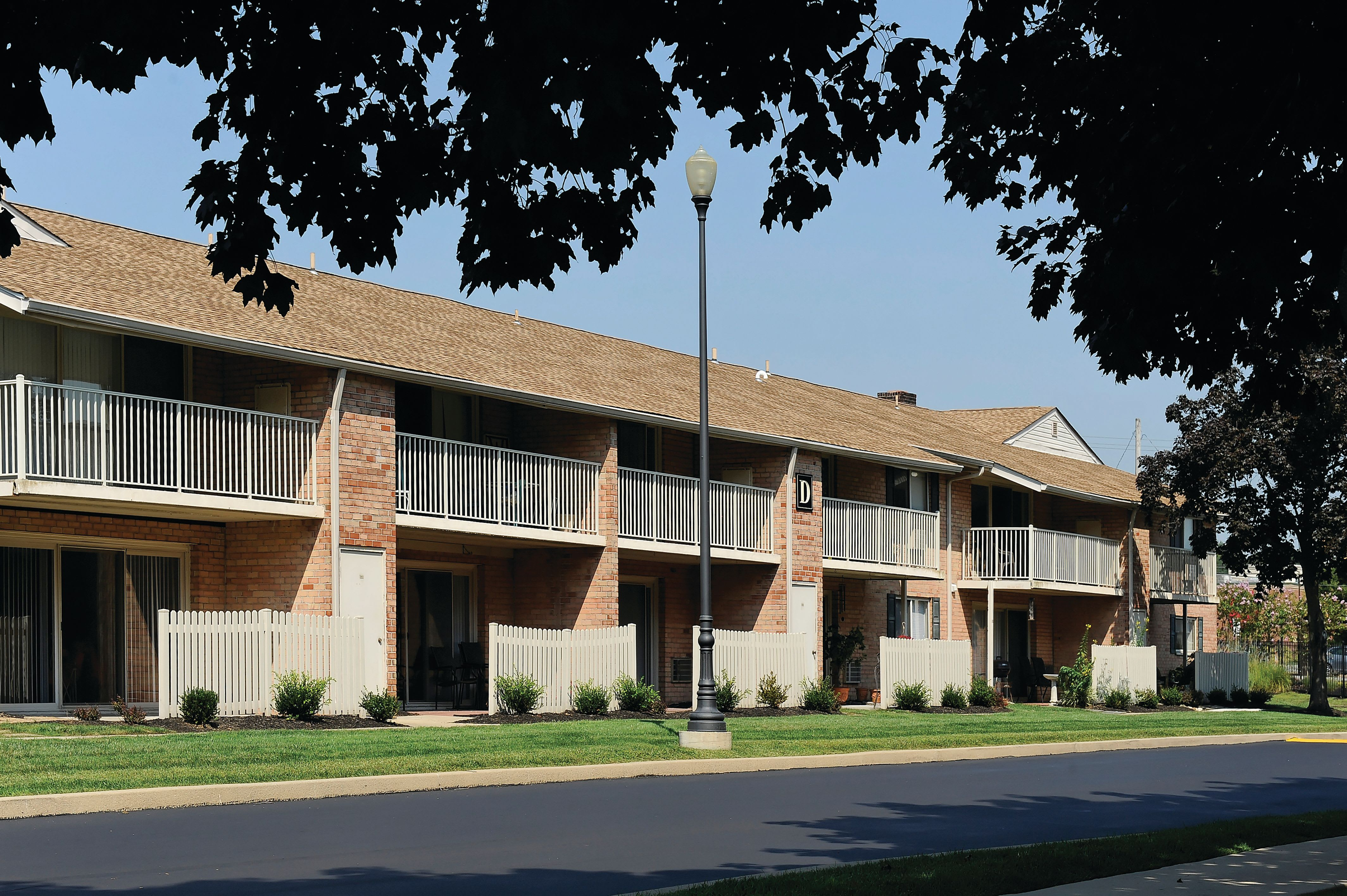 View of apartments with the first floor patio and second floor balconies at Golf Club Apartments in West Chester, Pennsylvania