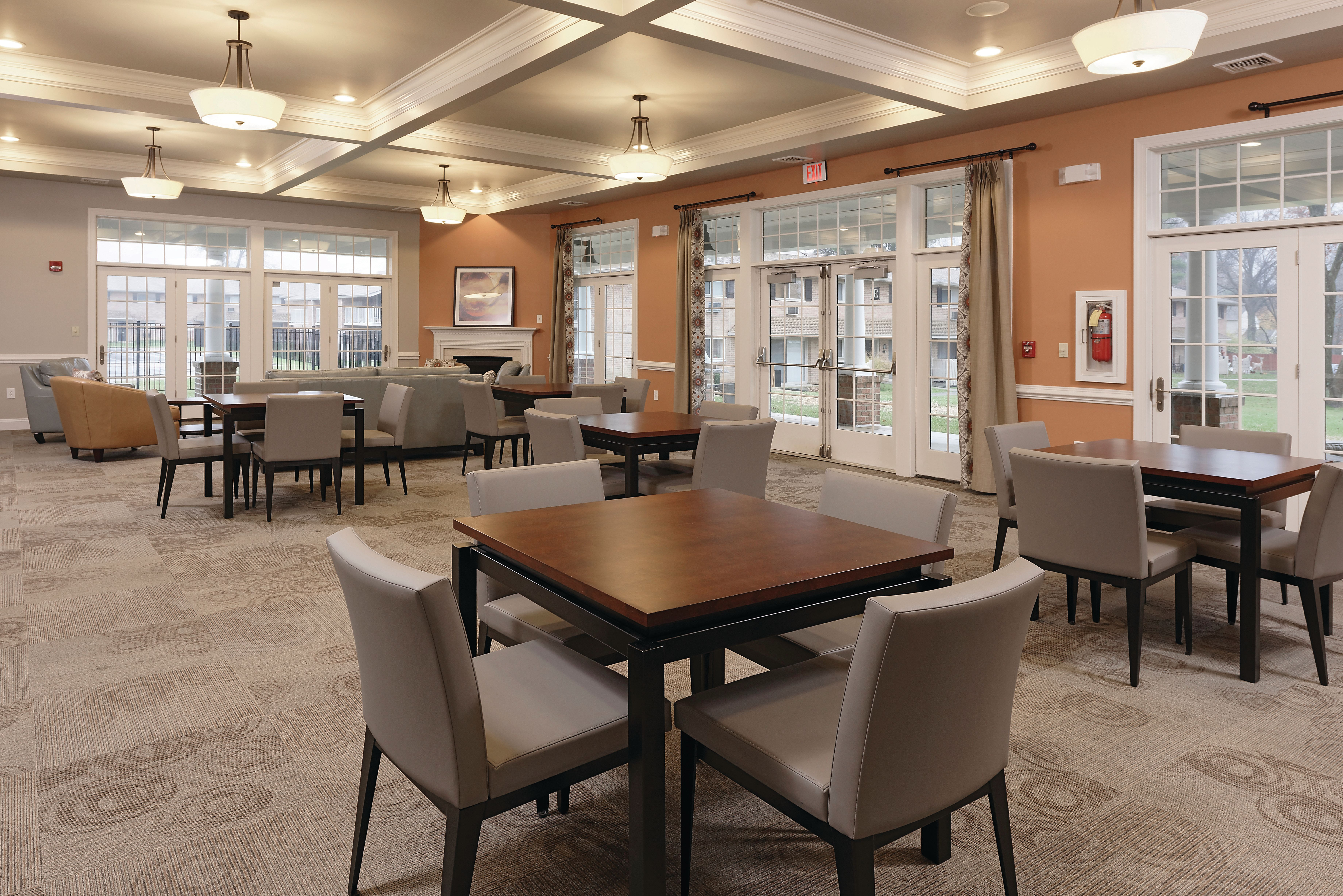 Tables and chairs inside community clubhouse at Golf Club Apartments in West Chester, Pennsylvania