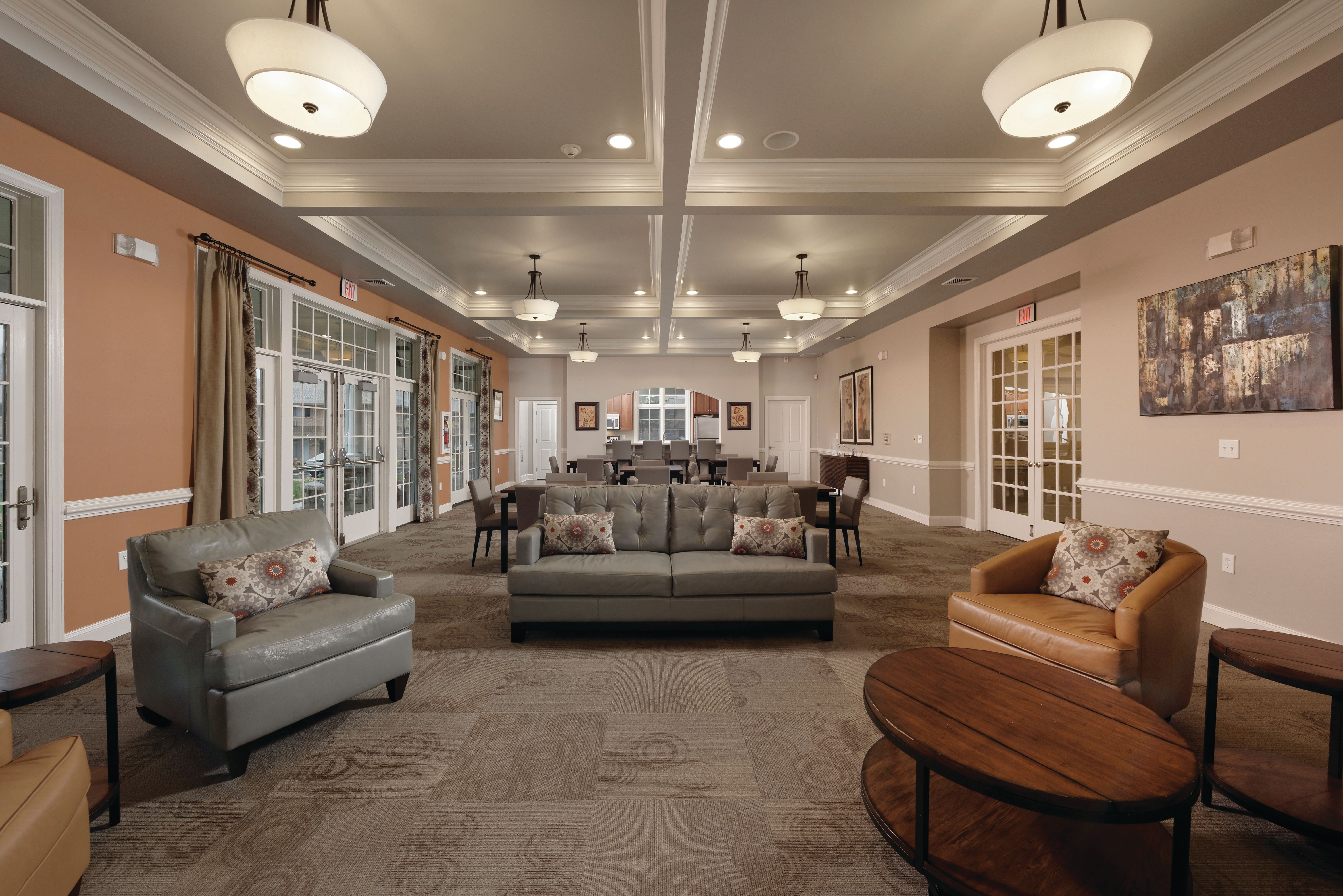 Clubhouse interior featuring a sitting area at Golf Club Apartments in West Chester, Pennsylvania