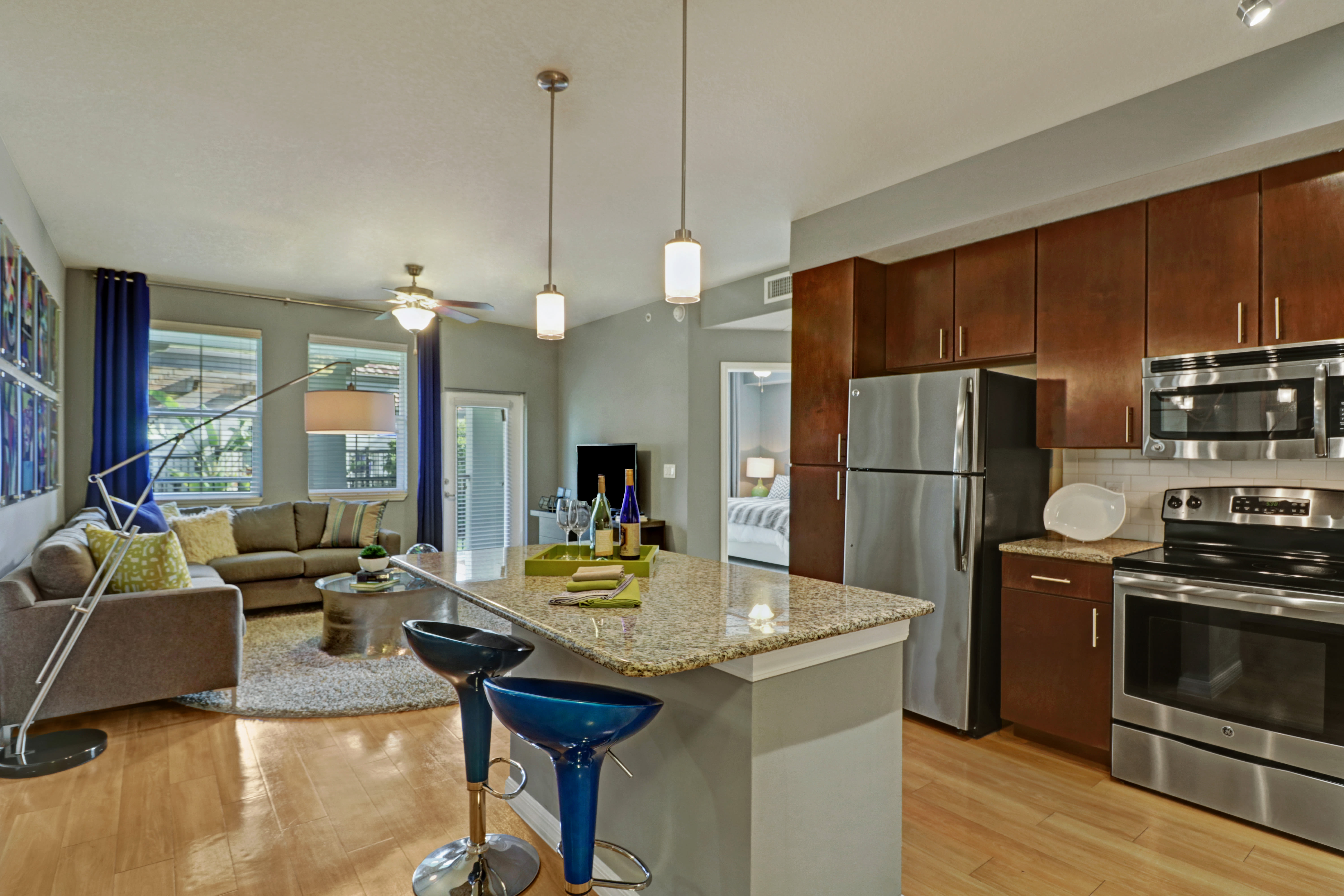 View of kitchen and living room in an apartment at Linden Pointe in Pompano Beach, Florida