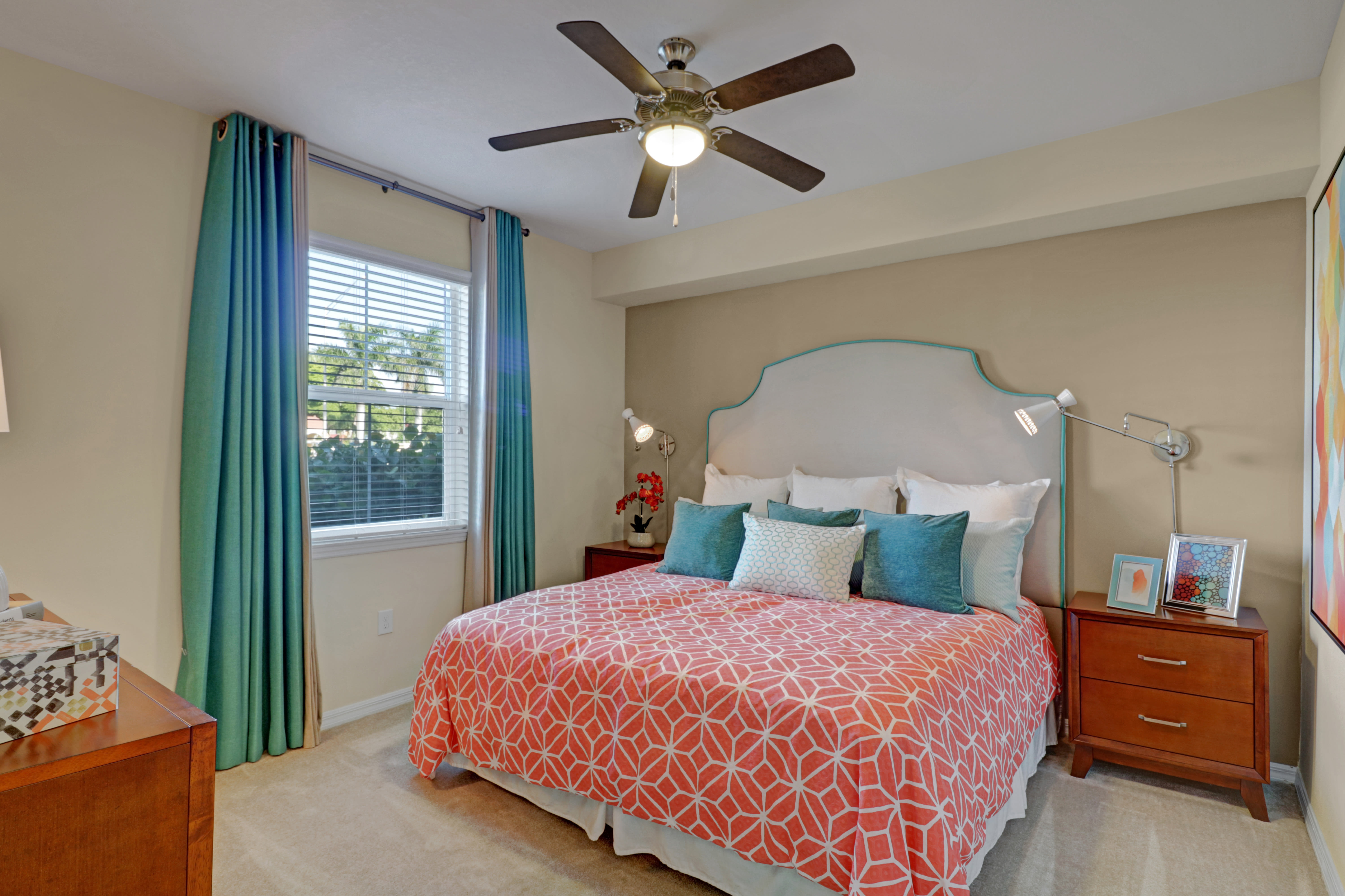 Comfortable bedroom with ceiling fan at Linden Pointe in Pompano Beach, Florida