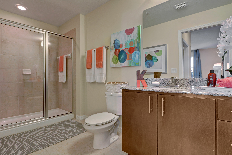 Bathroom at Linden Pointe in Pompano Beach, Florida features glass door shower bathtub