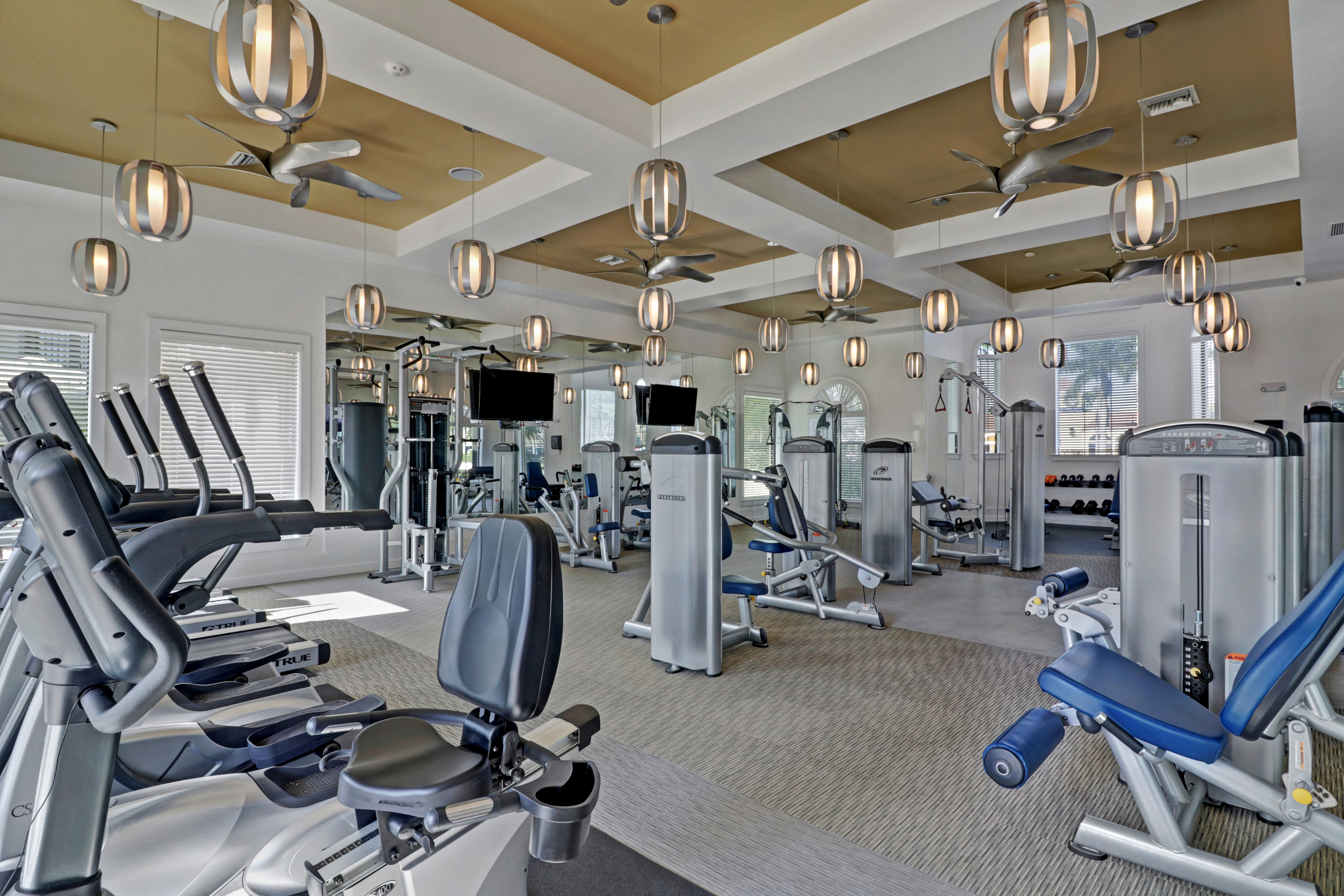 Modern exercise equipment in fitness center at Linden Pointe in Pompano Beach, Florida