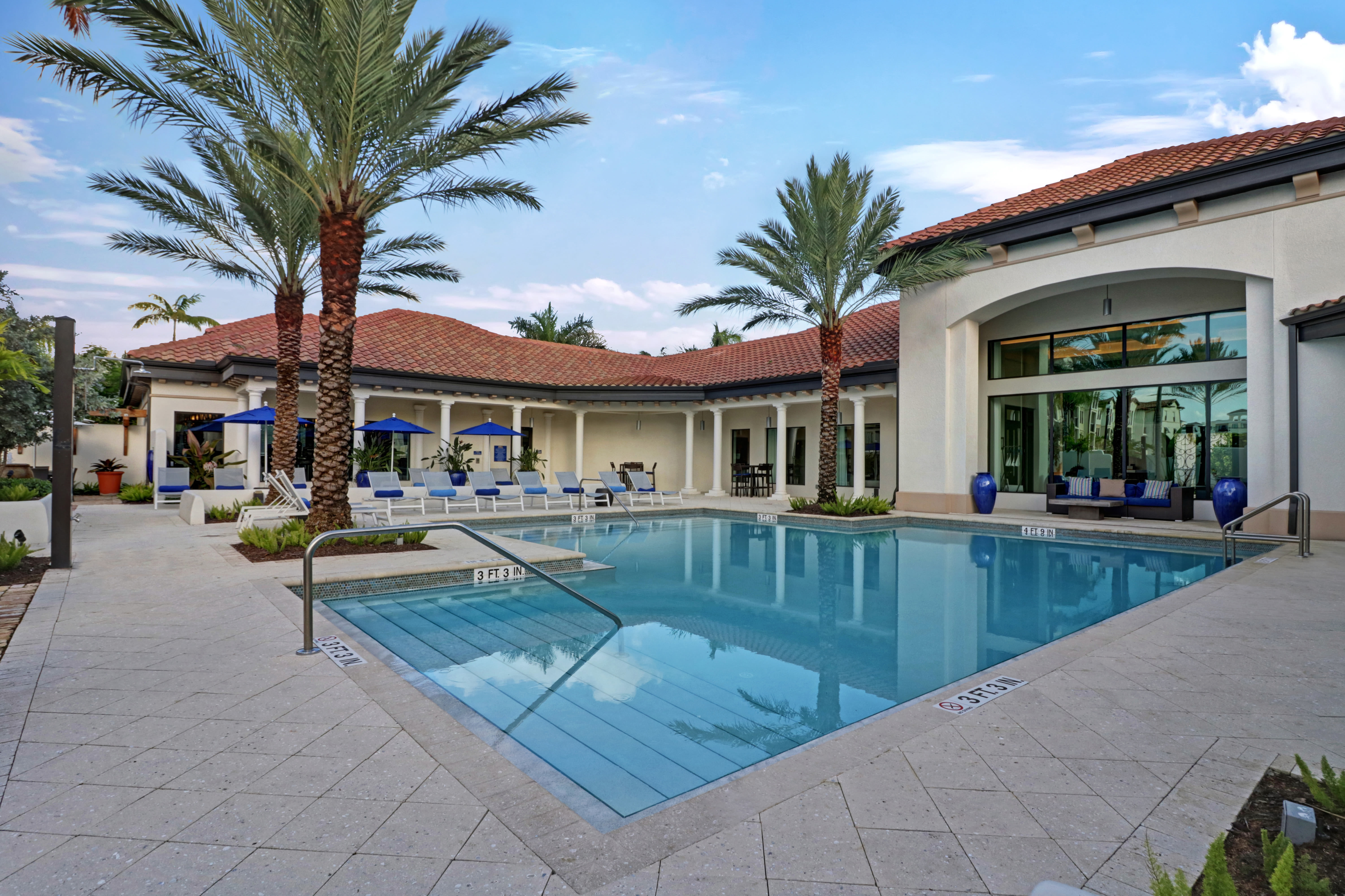 Community clubhouse and swimming pool at Linden Pointe in Pompano Beach, Florida
