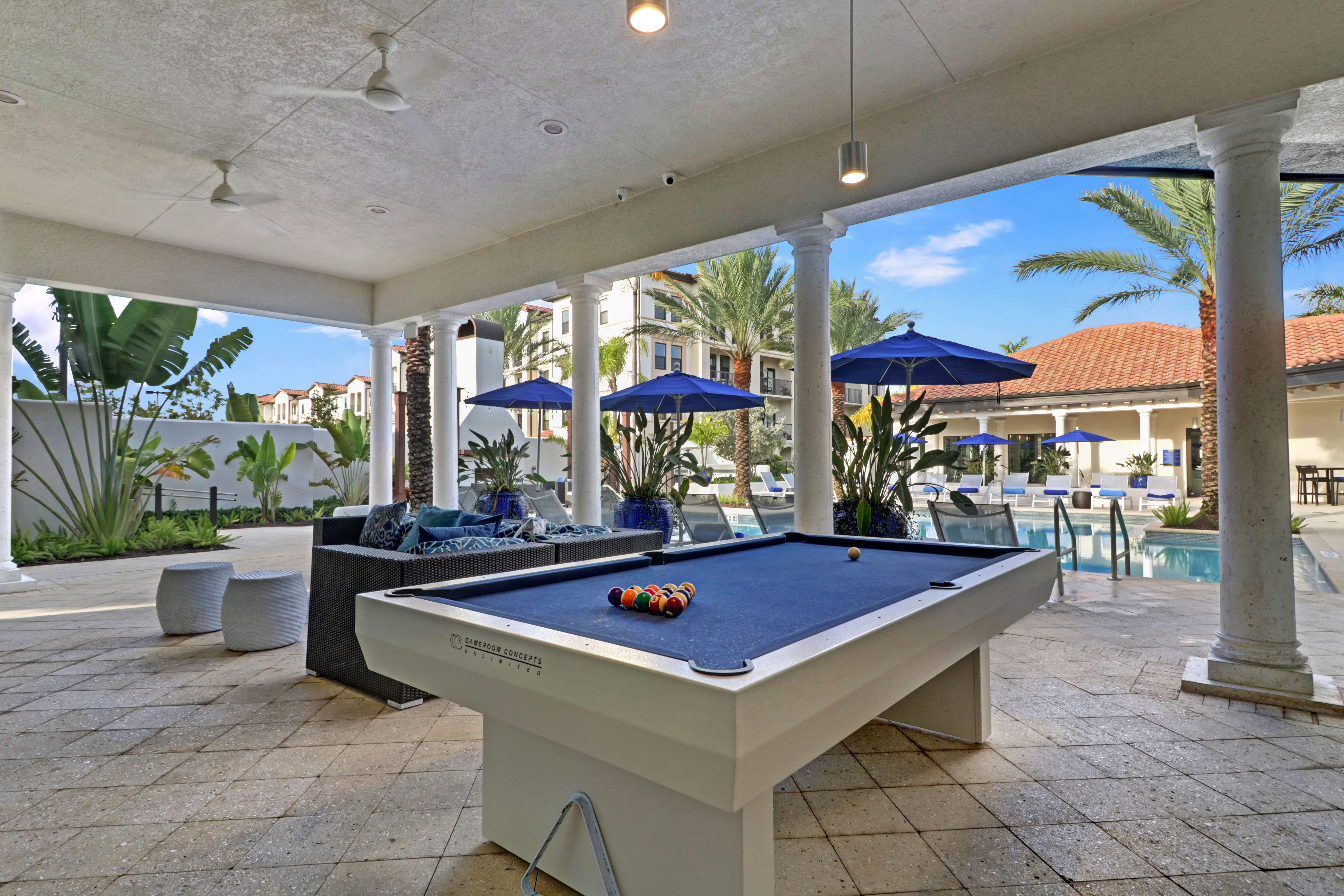 Billiards table located on outdoor patio space at Linden Pointe in Pompano Beach, Florida