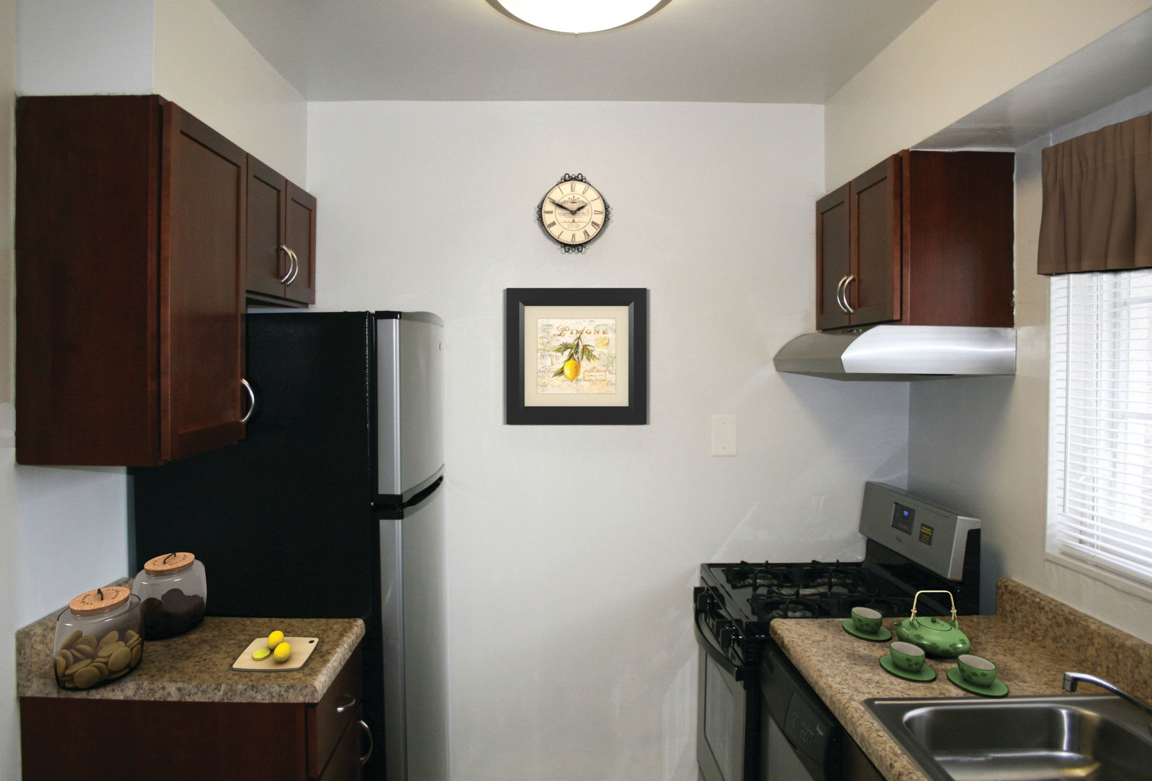 Kitchen featuring black appliances and ample counter top space at Braddock Lee Apartments in Alexandria, Virginia