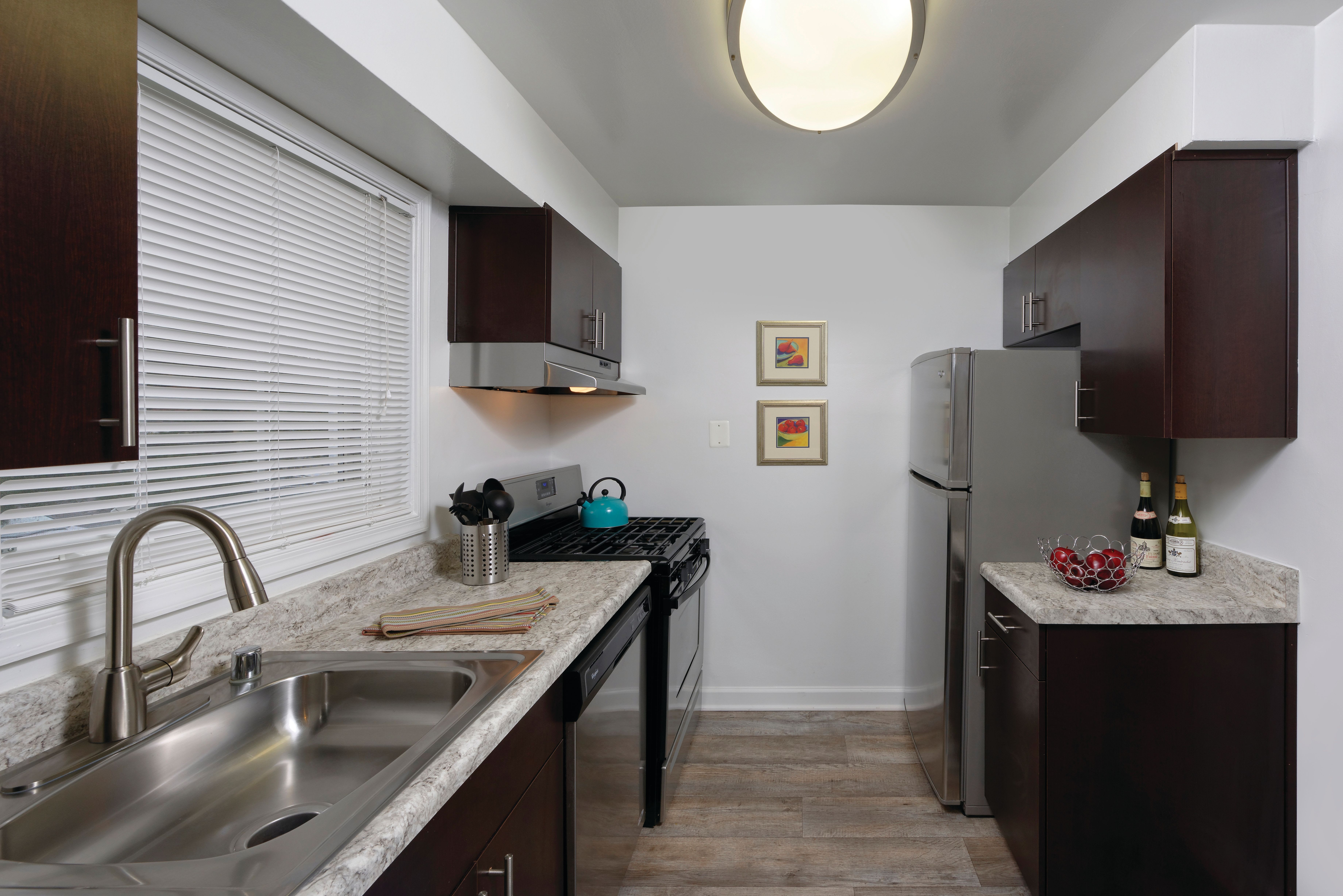 Kitchen with modern appliances and high end amenities at Braddock Lee Apartments in Alexandria, Virginia