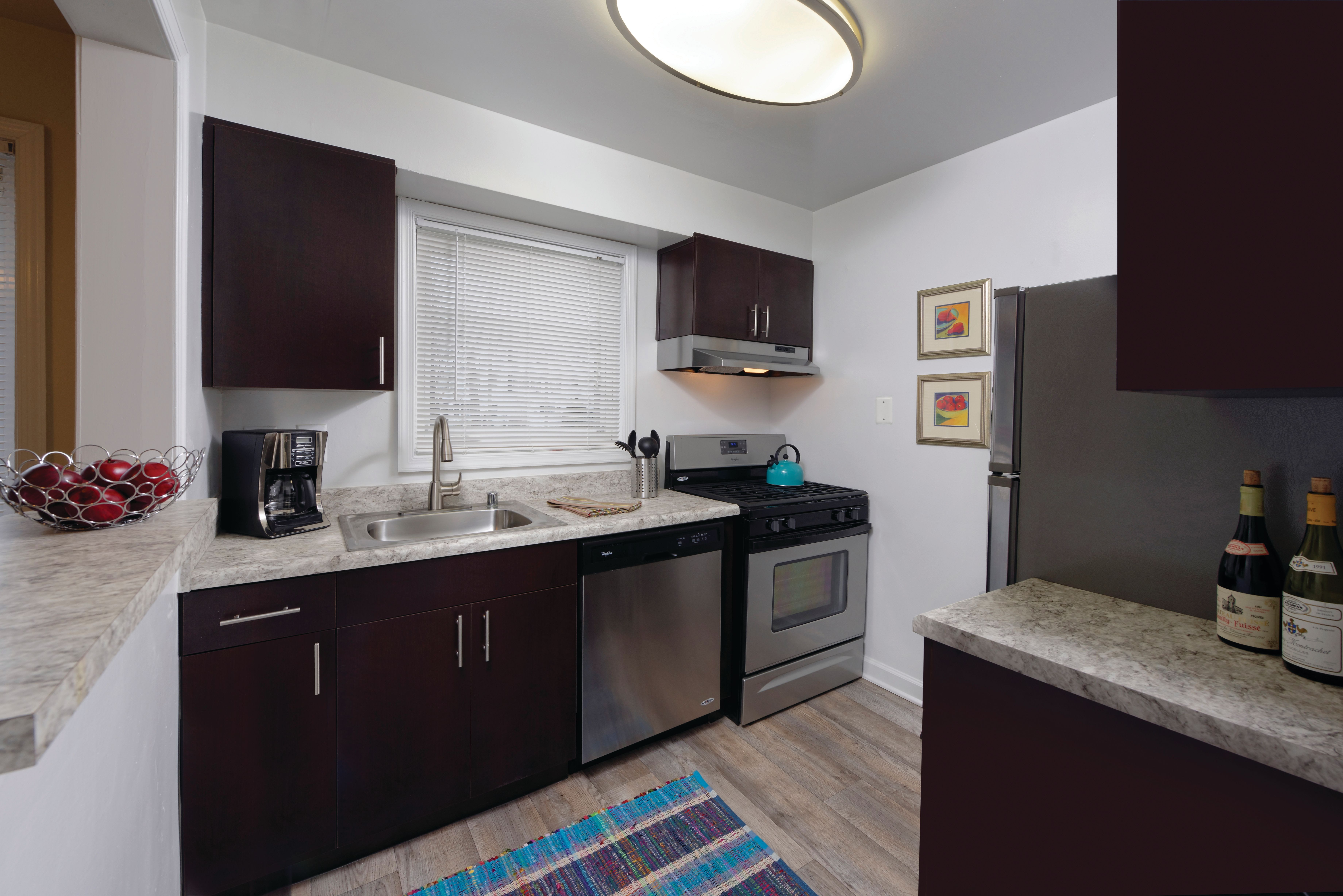 Black appliances in an apartment kitchen at Braddock Lee Apartments in Alexandria, Virginia