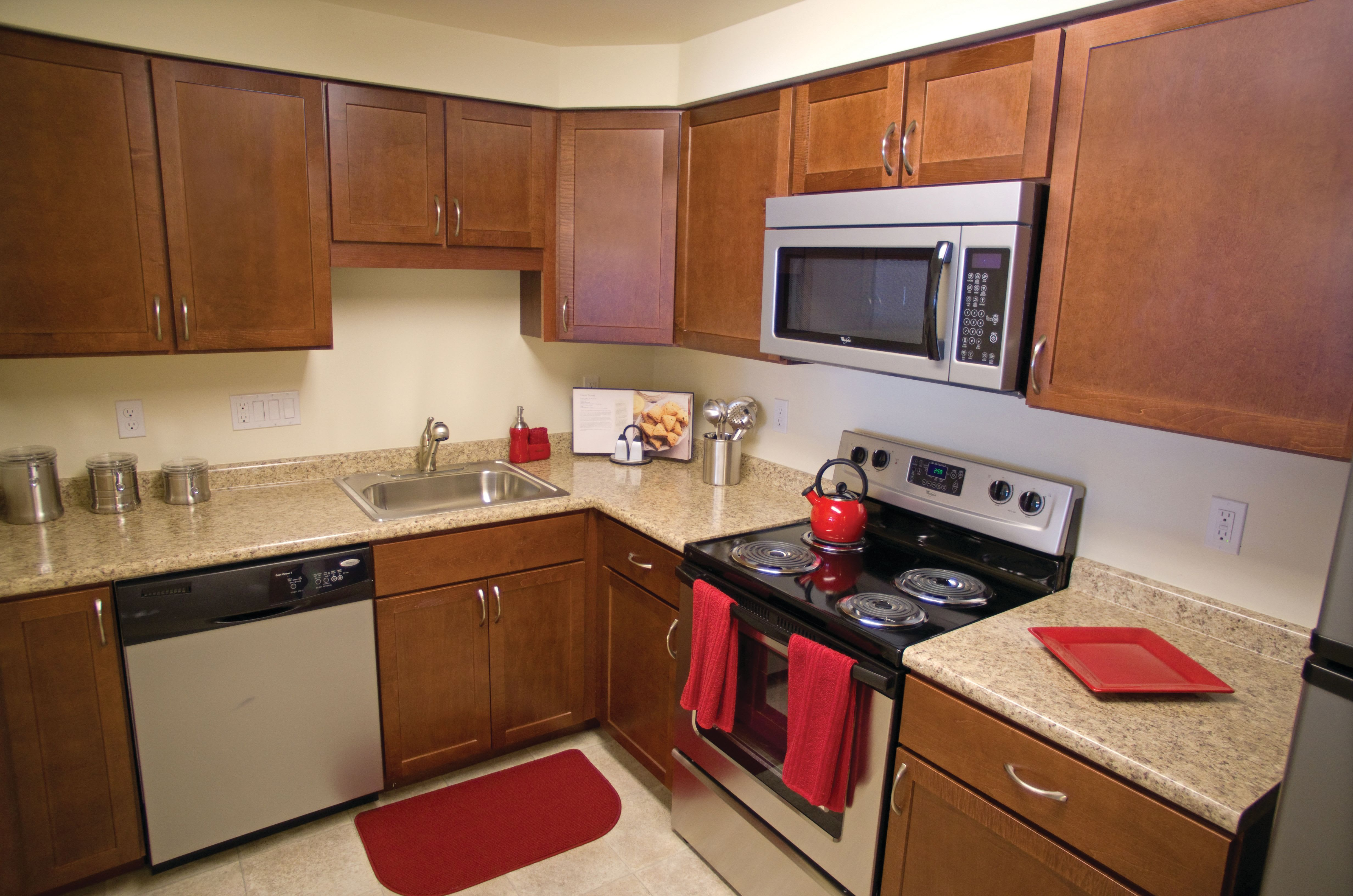 Kitchen with stainless steel appliances at Gardencrest in Waltham, Massachusetts
