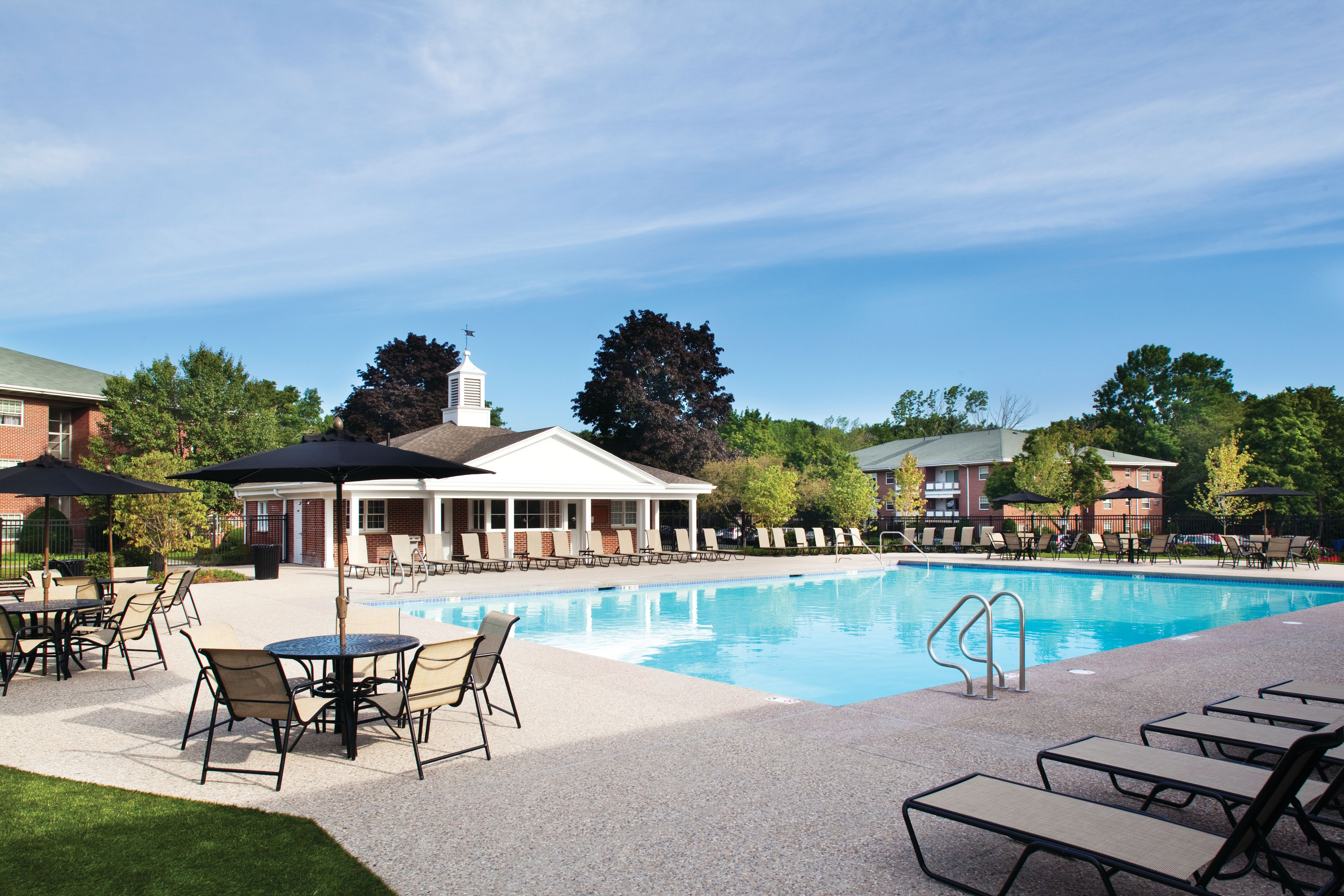 Lounge seating by pool at Gardencrest in Waltham, Massachusetts