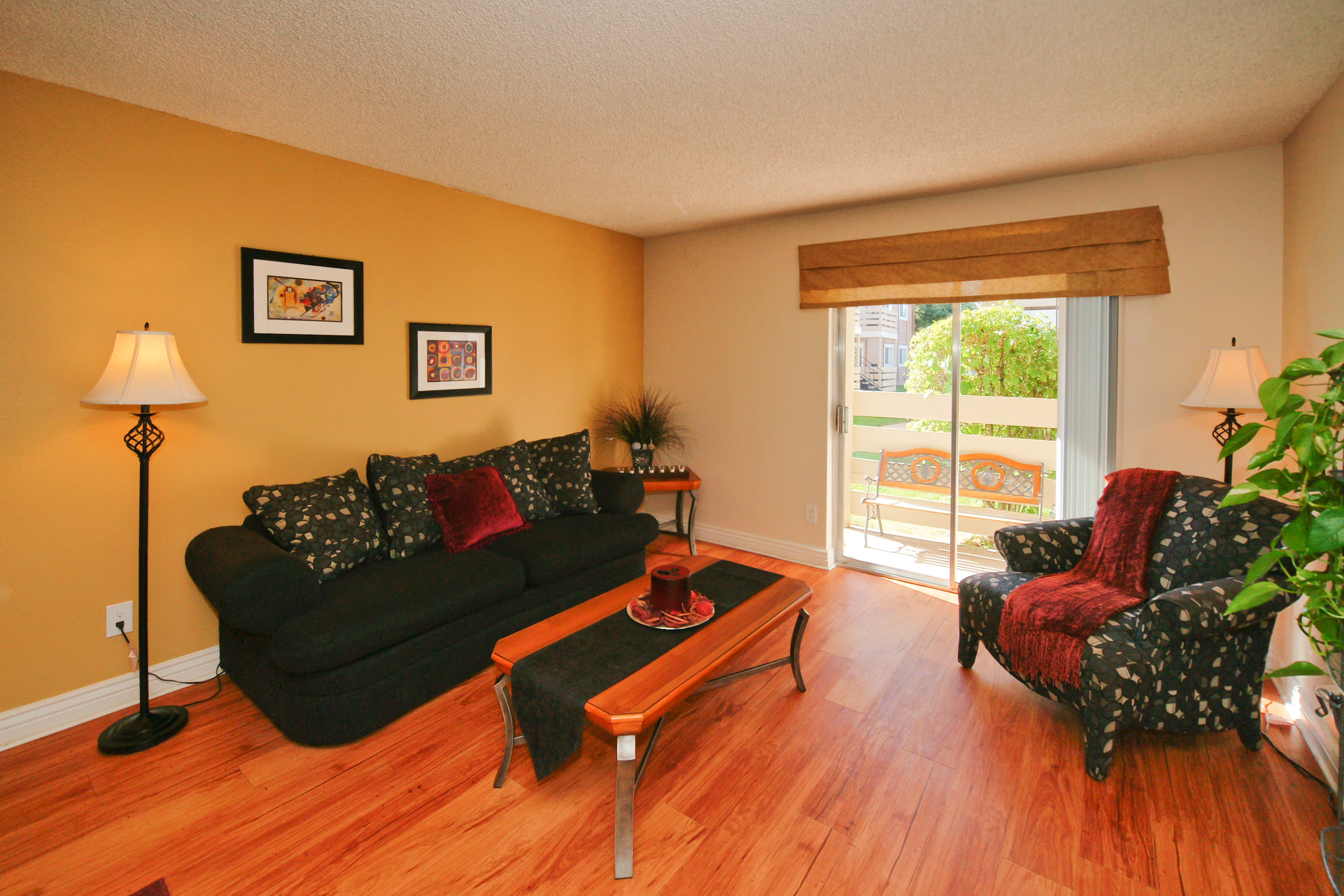 Living room with hardwood floors at Hampden Heights Apartments in Denver, Colorado