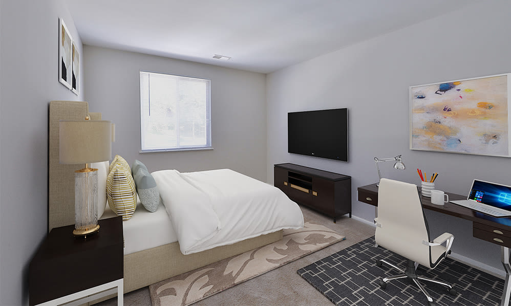 Cozy bedroom at Skylark Pointe Apartment Homes in Parkville, Maryland