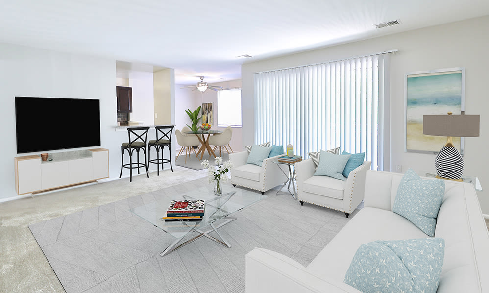Naturally well-lit living room at Skylark Pointe Apartment Homes in Parkville, Maryland
