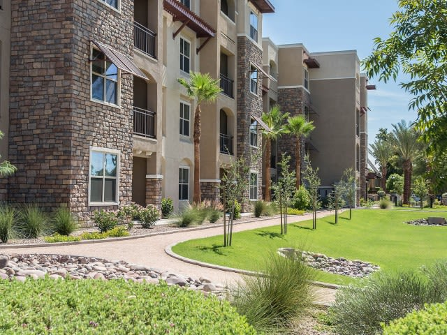 Walkways outside of apartment buildings at Luxe Scottsdale Apartments in Scottsdale, Arizona