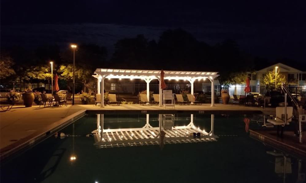 Beautiful pool sundeck at night at Woodview at Marlton Apartment Homes in Marlton, New Jersey
