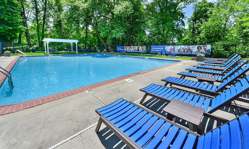 Swimming pool and sundeck at The Villas at Bryn Mawr Apartment Homes in Bryn Mawr, Pennsylvania
