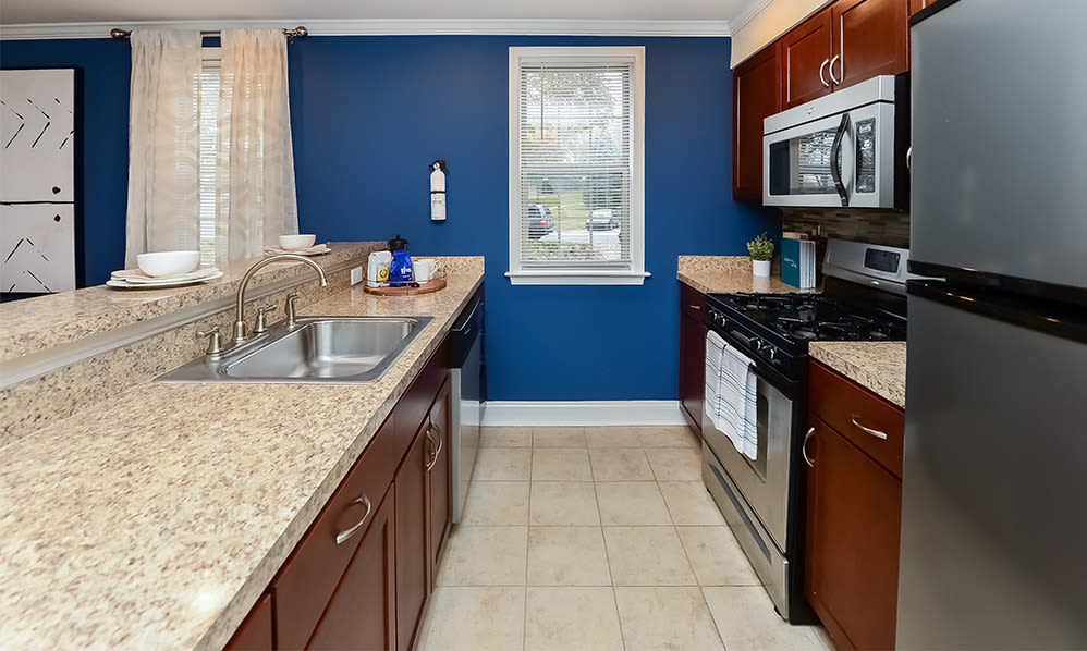 Spacious kitchen with stainless appliances at The Villas at Bryn Mawr Apartment Homes